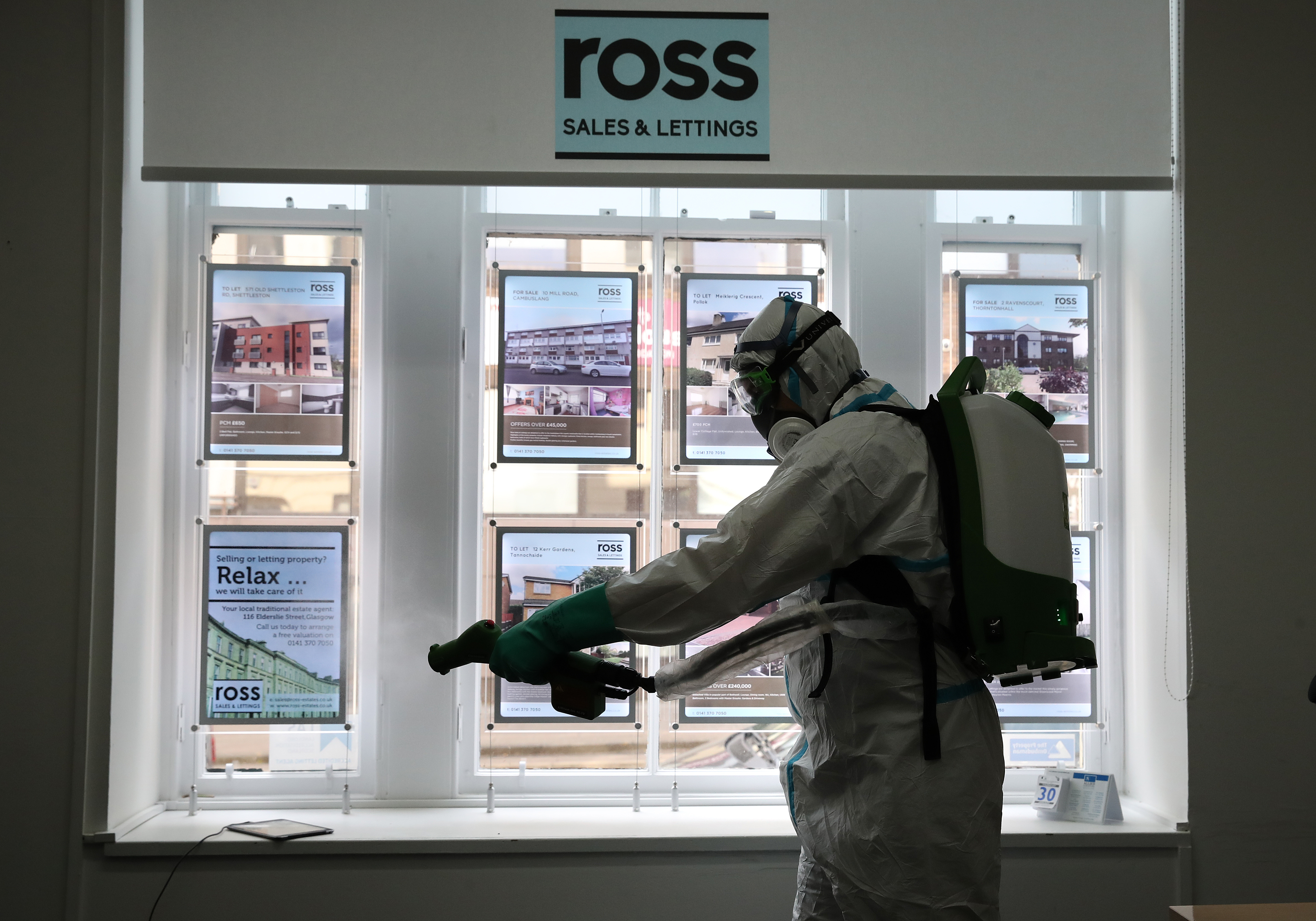 Steven Butterly from Azurablu Scotland Ltd during an electrostatic disinfection clean which follows a deep clean at Ross Sales and Lettings in Glasgow. (Photo by Andrew Milligan/PA Images via Getty Images)