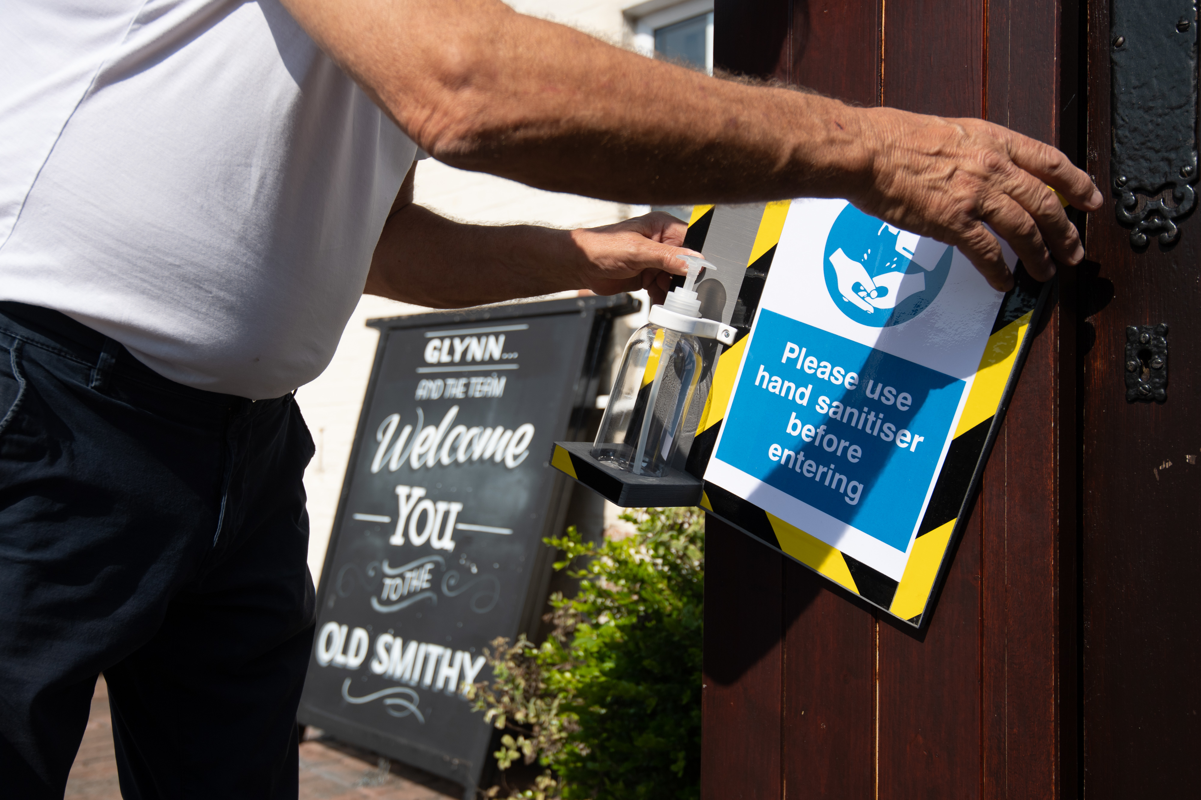 """Phil Weaver, owner of The Old Smith in Church Lawford, Warwickshire installs hand sanitising stations, as pub and hospitality bosses have cheered the Government's proposals to allow customers through their doors again on July 4 as """"a welcome relief""""."""