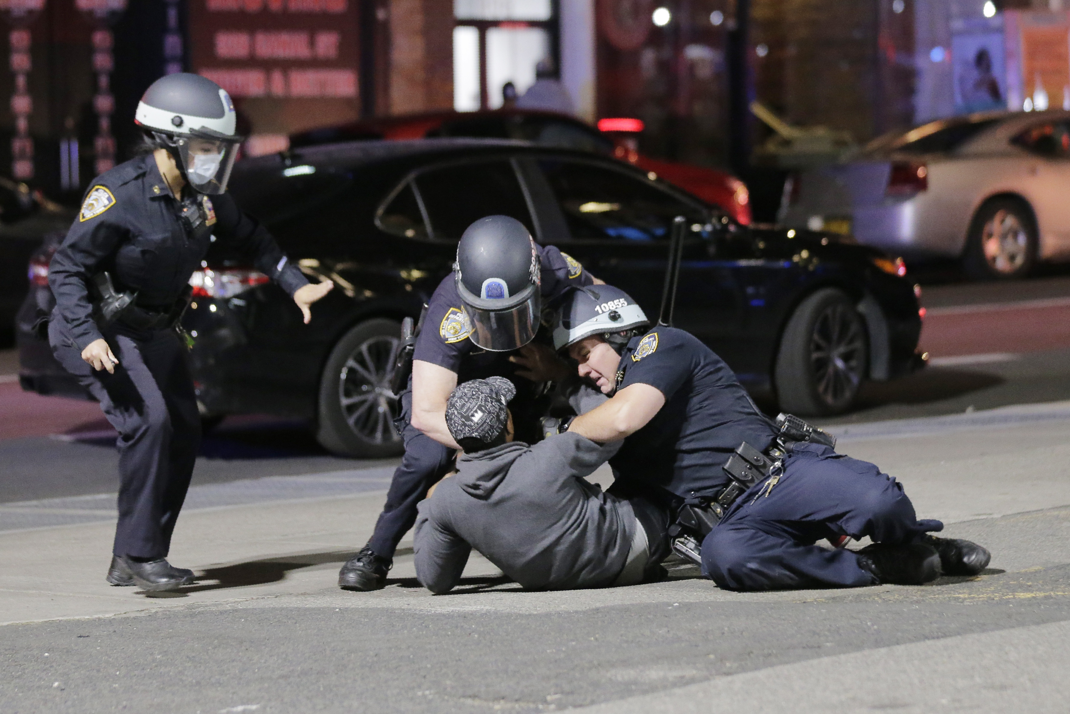 Police officers tackle a suspect trying to escape in New York, Monday, June 1, 2020. A fourth day of protests against police brutality kept New York City on edge Sunday, as thousands of people marched and many protesters and officers tried to keep the peace after days of unrest that left police cars burned and hundreds of people under arrest. (AP Photo/Seth Wenig)