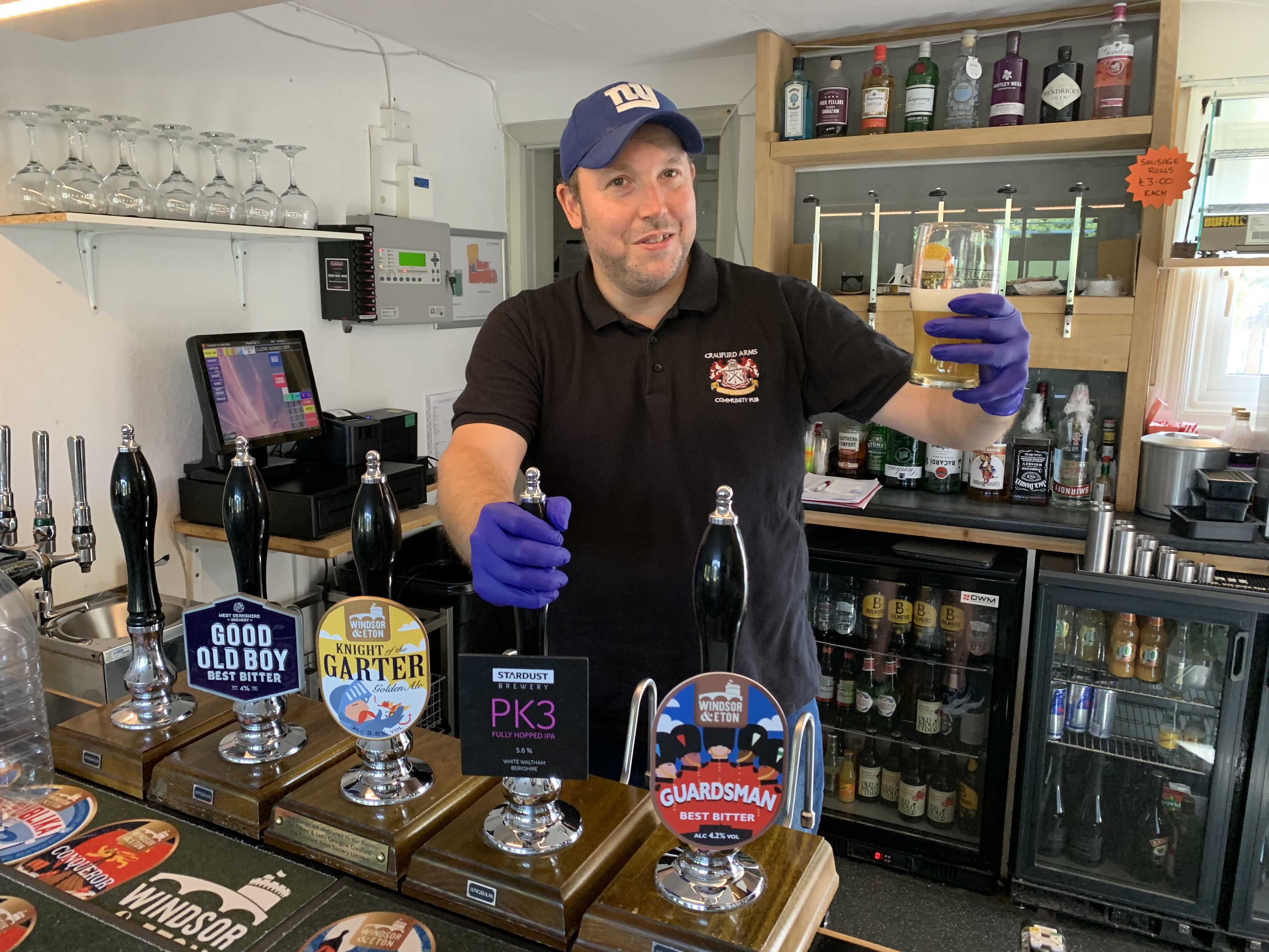 """Neil Piddington, general manager of the Craufurd Arms community-owned pub in Maidenhead, checks the beer after Prime Minister Boris Johnson said that pubs, restaurants and cinemas in England will be able to reopen from July 4, with """"one metre-plus"""" distancing measures in place as part of measures to ease the coronavirus lockdown."""