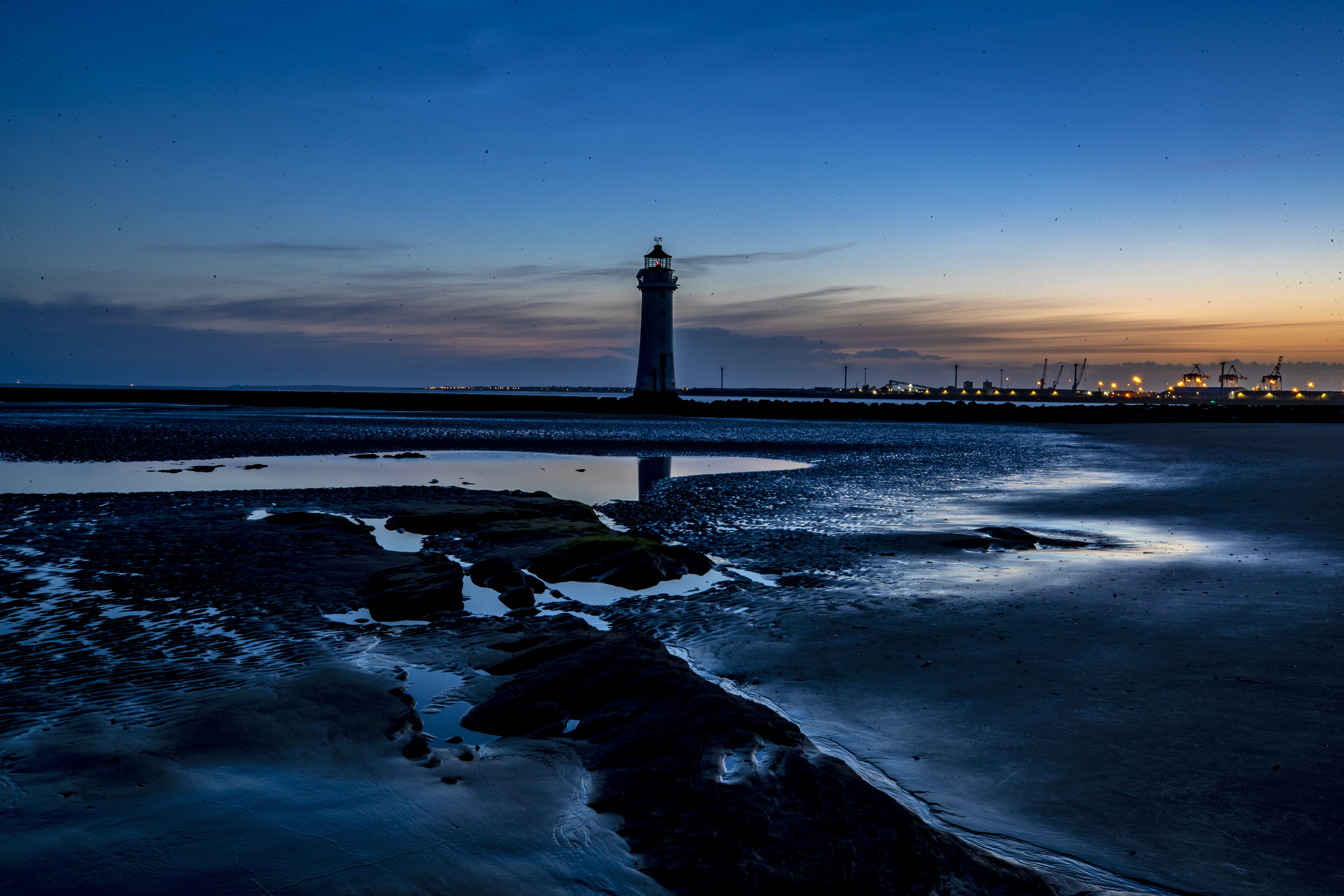 Twilight at dawn at New Brighton lighthouse during low tide on the River Mersey ahead of the chance that Britain could bask in the hottest day of the year so far this week. (Photo by Peter Byrne/PA Images via Getty Images)
