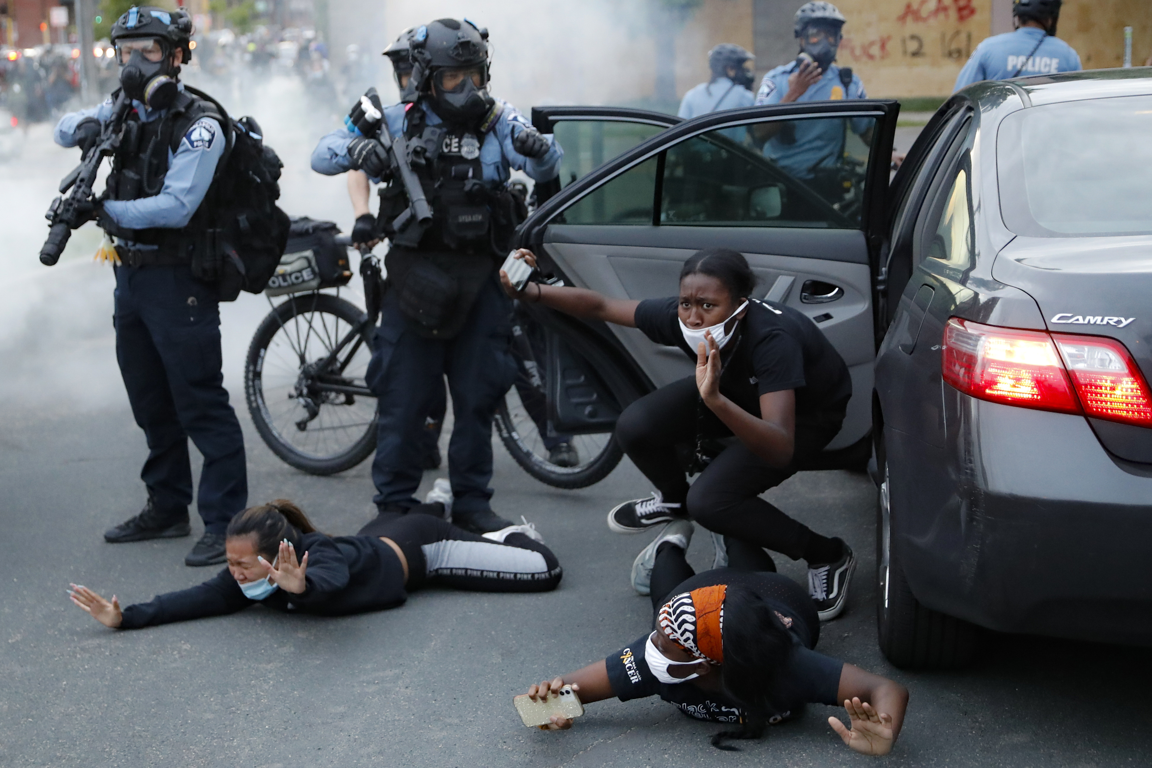 Motorists are ordered to the ground from their vehicle by police during a protest on South Washington Street, Sunday, May 31, 2020, in Minneapolis. Protests continued following the death of George Floyd, who died after being restrained by Minneapolis police officers on Memorial Day. (AP Photo/John Minchillo)