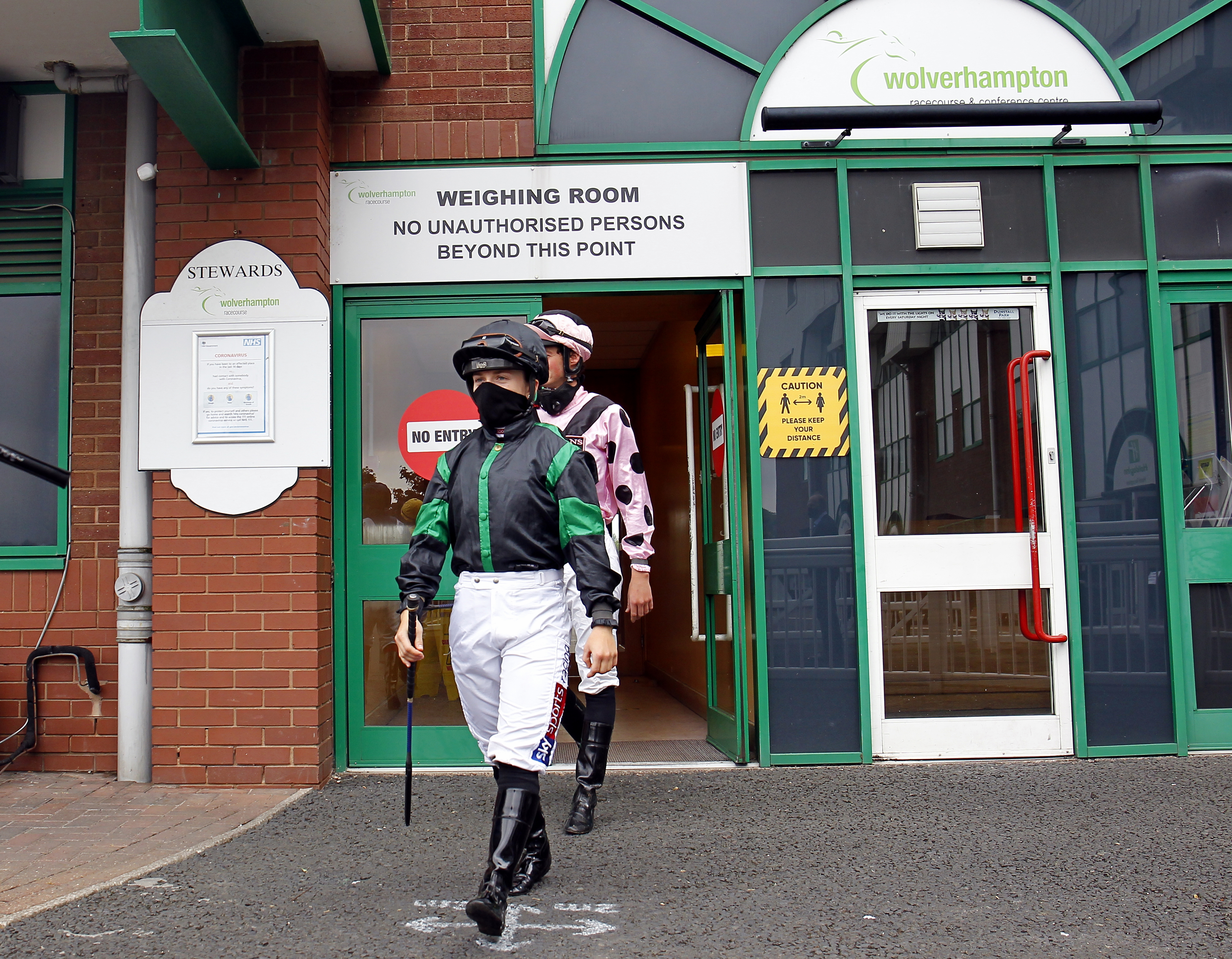 WOLVERHAMPTON, ENGLAND - JUNE 12: Hollie Doyle heads out of the weighing room to the paddock prior to a race at Wolverhampton Racecourse on June 12, 2020 in Wolverhampton, England. (Photo by Steve Davies/Pool via Getty Images)