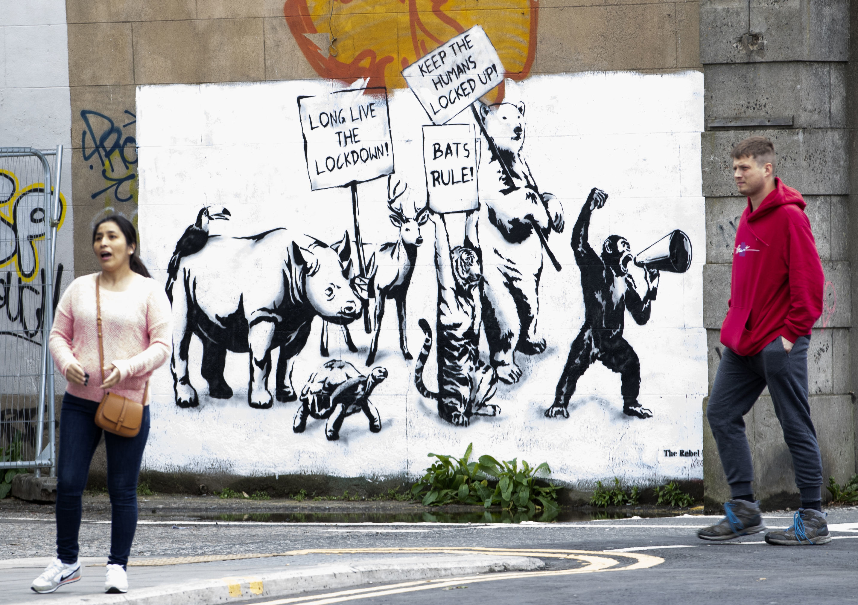 A new piece of street art by The Rebel Bear has appeared on a wall in Leith, Scotland, as Scotland is moving into phase one of the Scottish Government's plan for gradually lifting lockdown, Wednesday June 3, 2020. Scotland and Wales have developed separate procedures from England to gradually allow the lifting of lockdown restrictions because of the COVID-19 coronavirus.  (Jane Barlow/PA via AP)