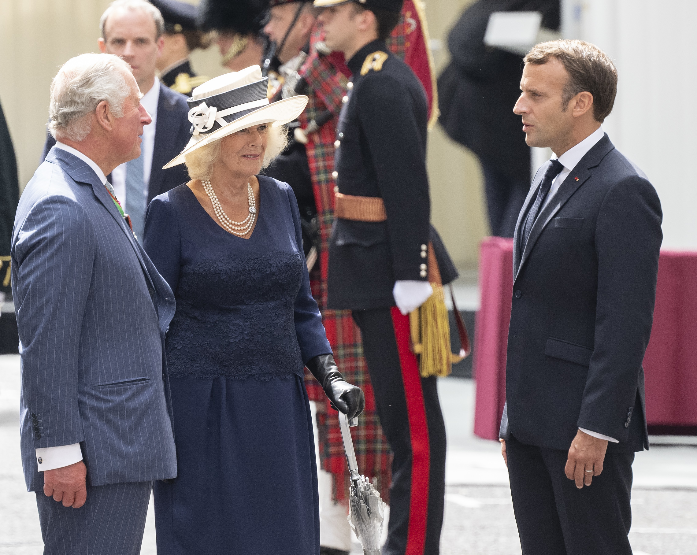 """French President Emmanuel Macron meets Prince Charles, Prince of Wales and Camilla, Duchess of Cornwall during a ceremony at Carlton Gardens. The French president is visiting London on June 18, 2020 to commemorate the 80th anniversary of Charles de Gaulle's BBC broadcast to occupied France following the Nazi invasion in 1940 """"Appel"""" ."""