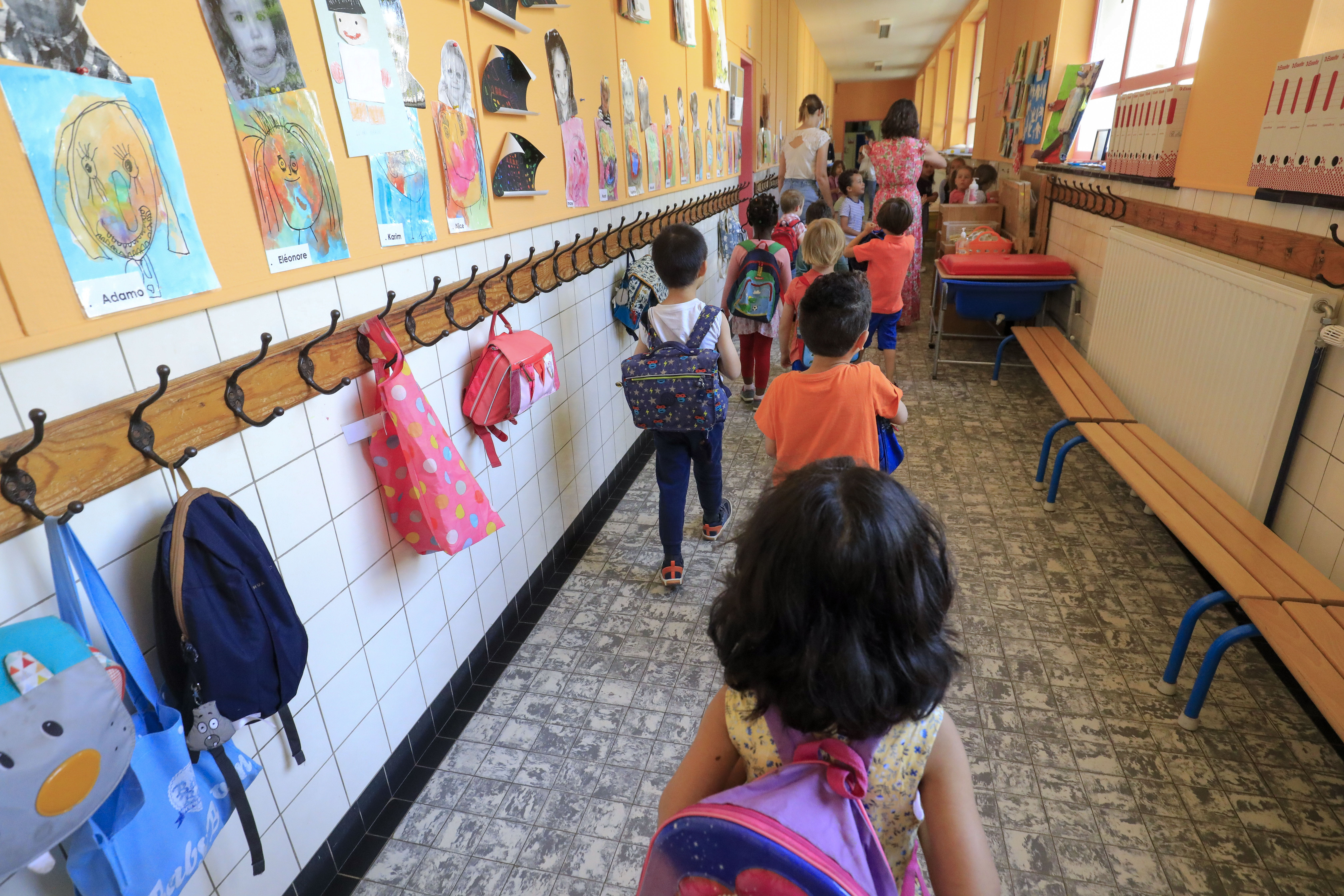 Illustration picture shows kids and their schoolbags in the hall outside their classroom, in a kindergarden school in Etterbeek, Brussels, Tuesday 02 June 2020. Schools for children under six years old are reopening today for everyone. Belgium is in its twelfth week of confinement in the ongoing corona virus crisis and the third week of the phase 2 of the deconfinement. BELGA PHOTO THIERRY ROGE (Photo by THIERRY ROGE/BELGA MAG/AFP via Getty Images)