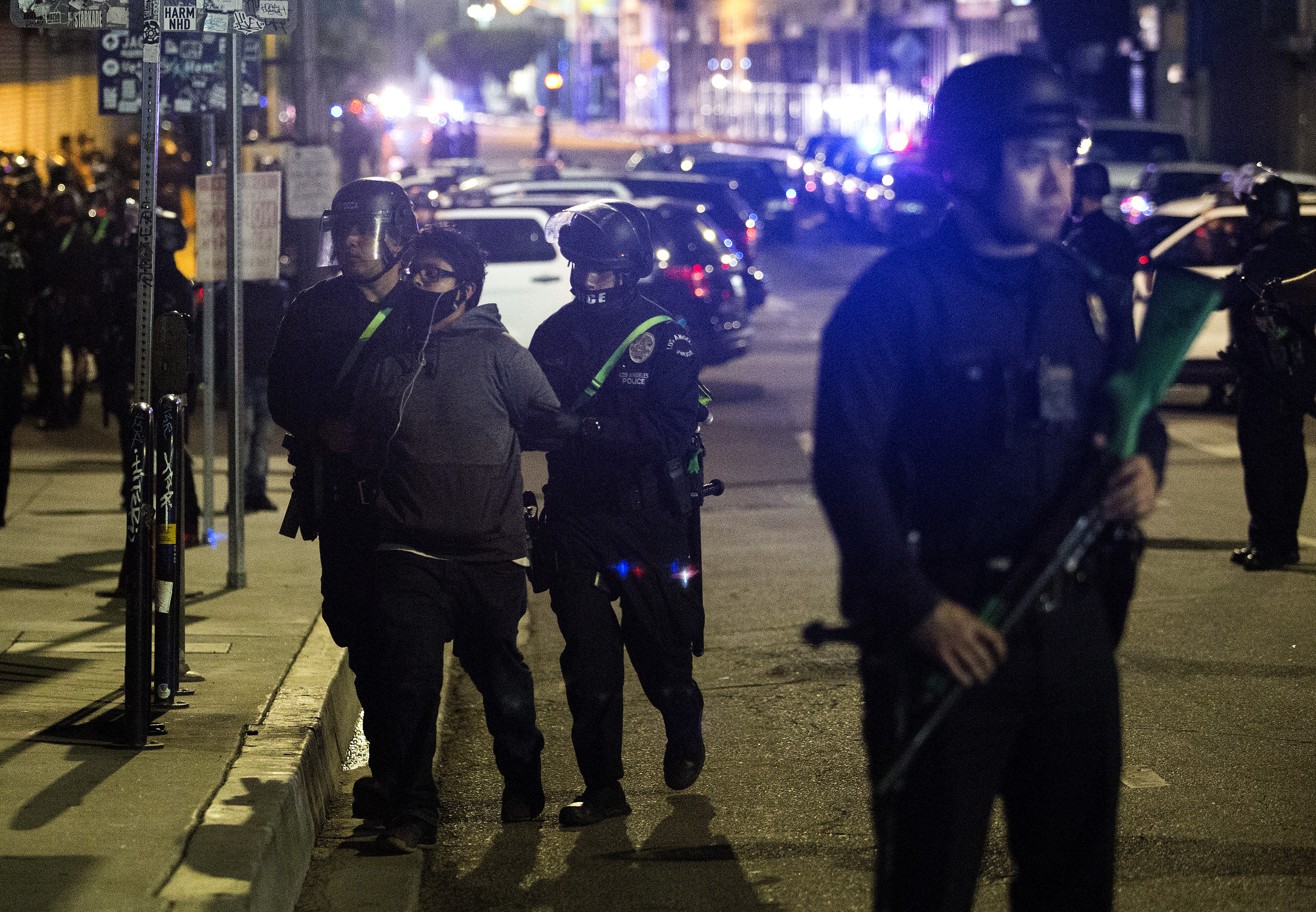 Police officers arrest a protester Sunday, May 31, 2020, in Los Angeles, during a protest over the death of George Floyd, who died May 25 after he was pinned at the neck by a Minneapolis police officer. (AP Photo/Ringo H.W. Chiu)