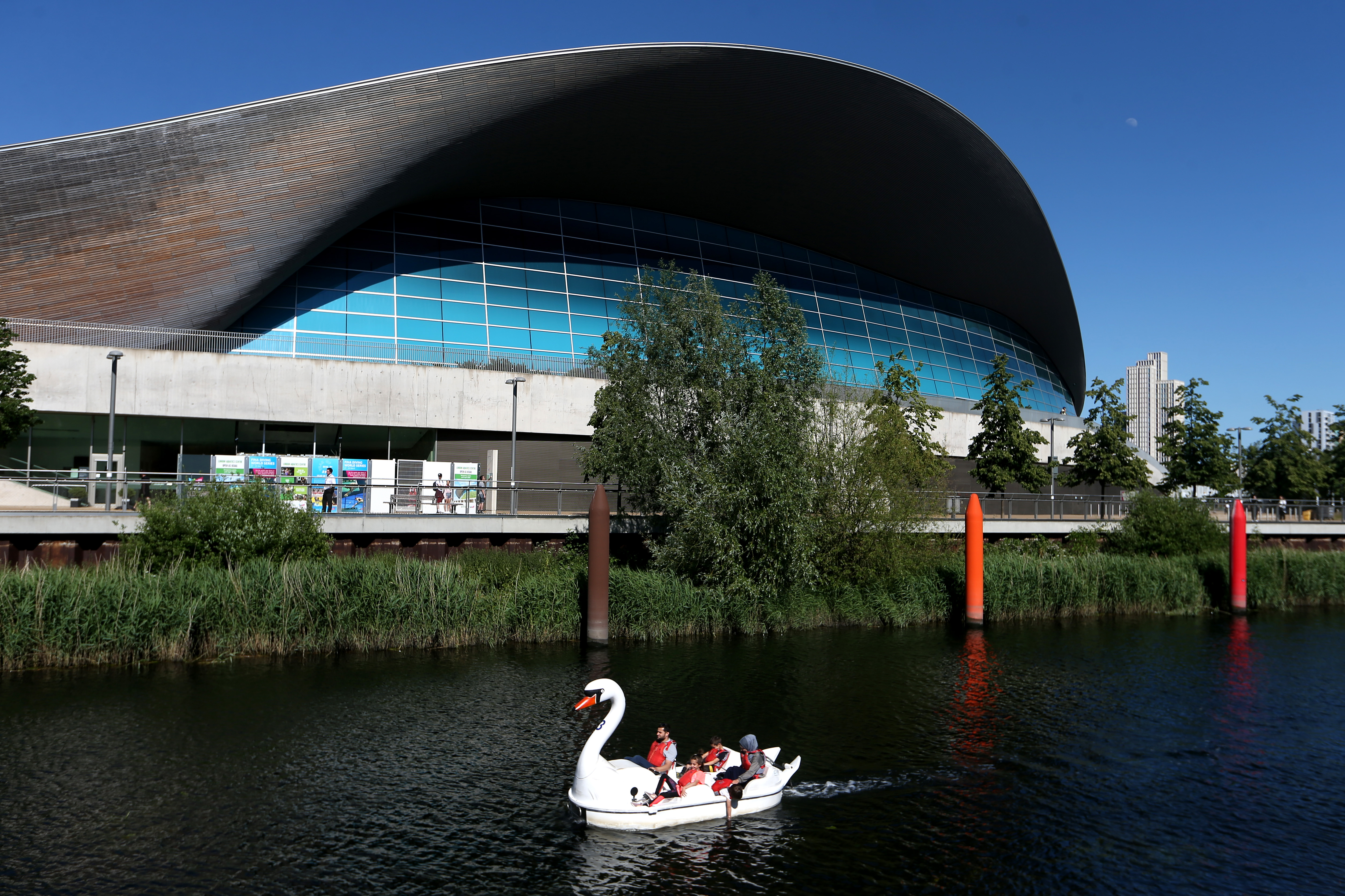 LONDON, ENGLAND  - MAY 31: People in pedalo's go through the Olympic Park in Stratford on May 31, 2020 in London, England. The British government continues to ease the coronavirus lockdown by announcing schools will open to reception year pupils plus years one and six from June 1st. Open-air markets and car showrooms can also open from the same date.  (Photo by Alex Pantling/Getty Images)