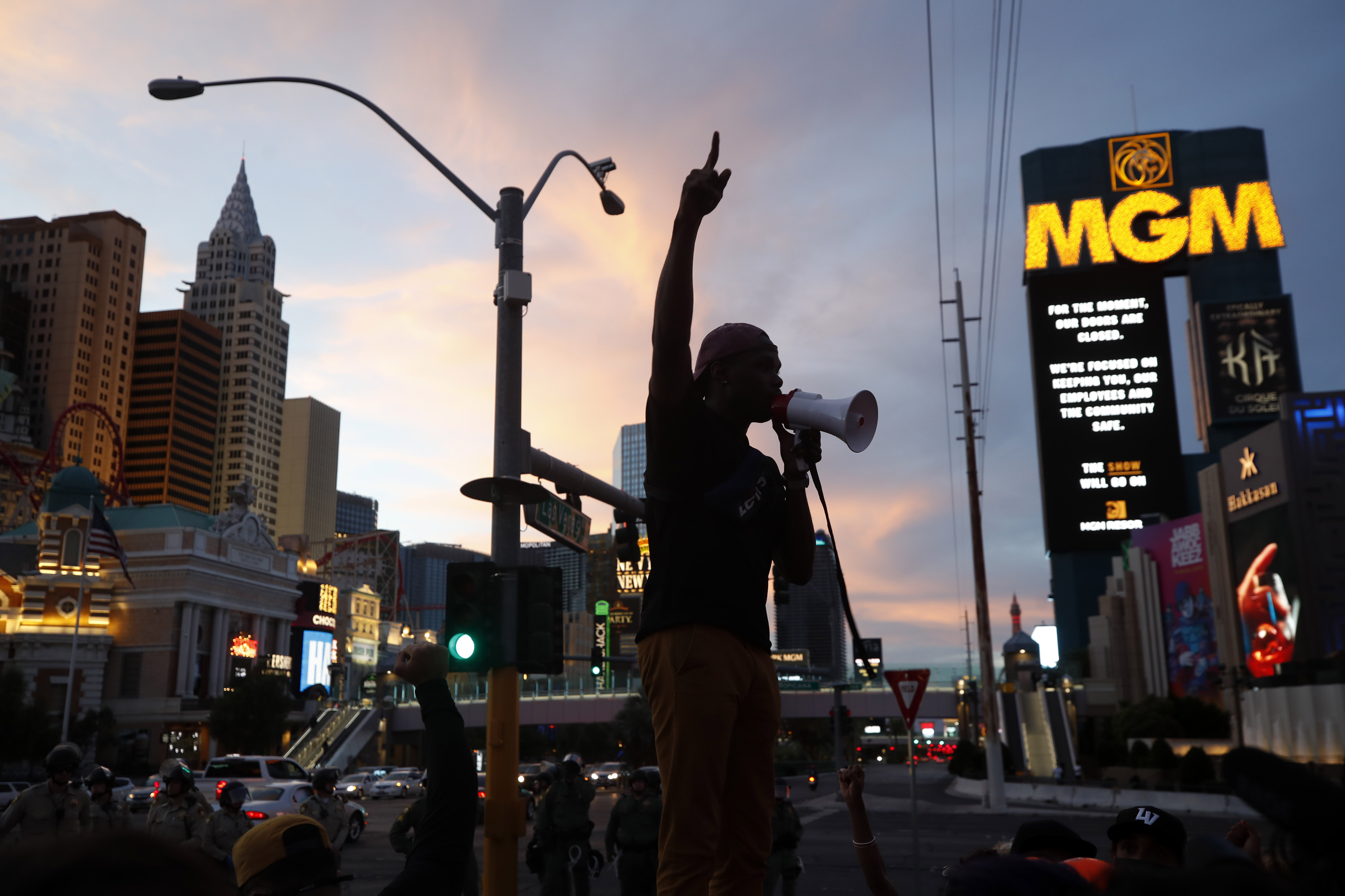 Protesters rally on the Las Vegas Strip Sunday, May 31, 2020, in Las Vegas, over the death of George Floyd, a black man who was in police custody in Minneapolis. Floyd died after being restrained by Minneapolis police officers on Memorial Day. (AP Photo/Steve Marcus)