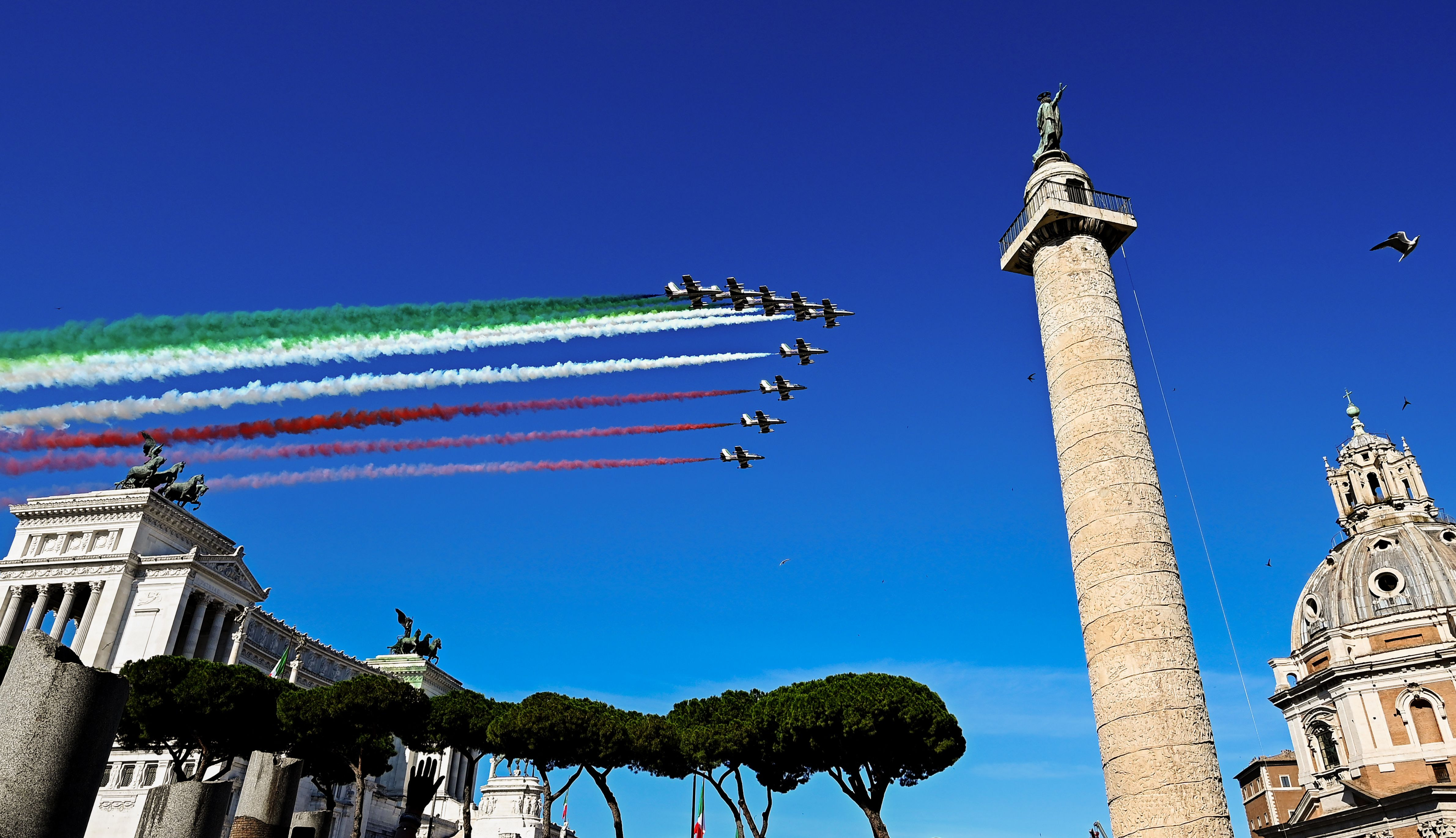 The Italian Air Force acrobatic unit Frecce Tricolori (Tricolored Arrows) perform over the Altare della Patria - King Vittorio Emanuele II monument and Trajan's column in Rome on June 2, 2020 as part of Republic Day ceremonies, as the country eases its lockdown aimed at curbing the spread of the COVID-19 infection, caused by the novel coronavirus. (Photo by Vincenzo PINTO / AFP) (Photo by VINCENZO PINTO/AFP via Getty Images)