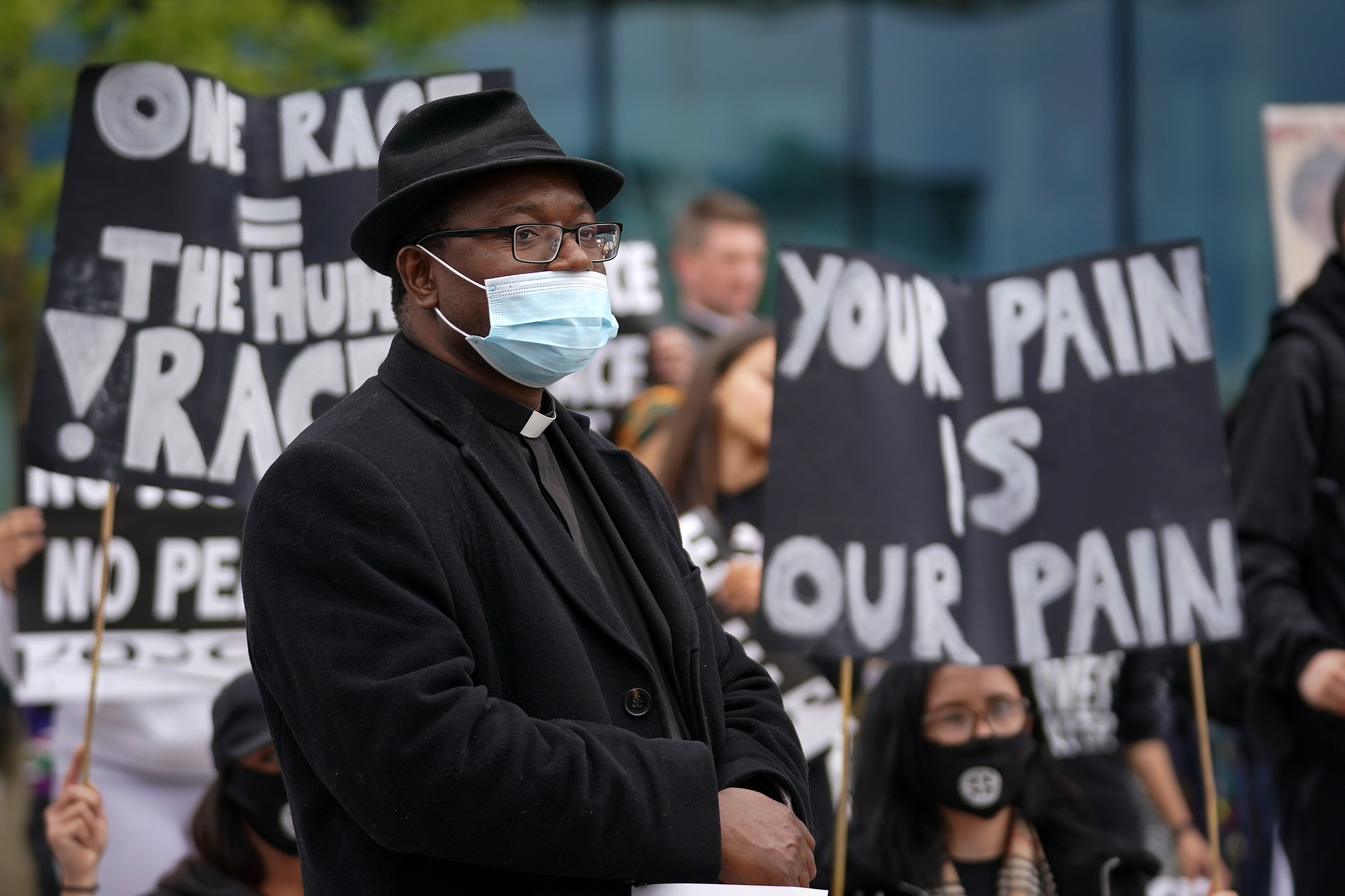 BIRMINGHAM, ENGLAND - JUNE 04: A man of the church takes part in  a Black Lives Matter demonstration on June 4, 2020 in Birmingham, United Kingdom. The death of an African-American man, George Floyd, while in the custody of Minneapolis police has sparked protests across the United States, as well as demonstrations of solidarity in many countries around the world. (Photo by Christopher Furlong/Getty Images)