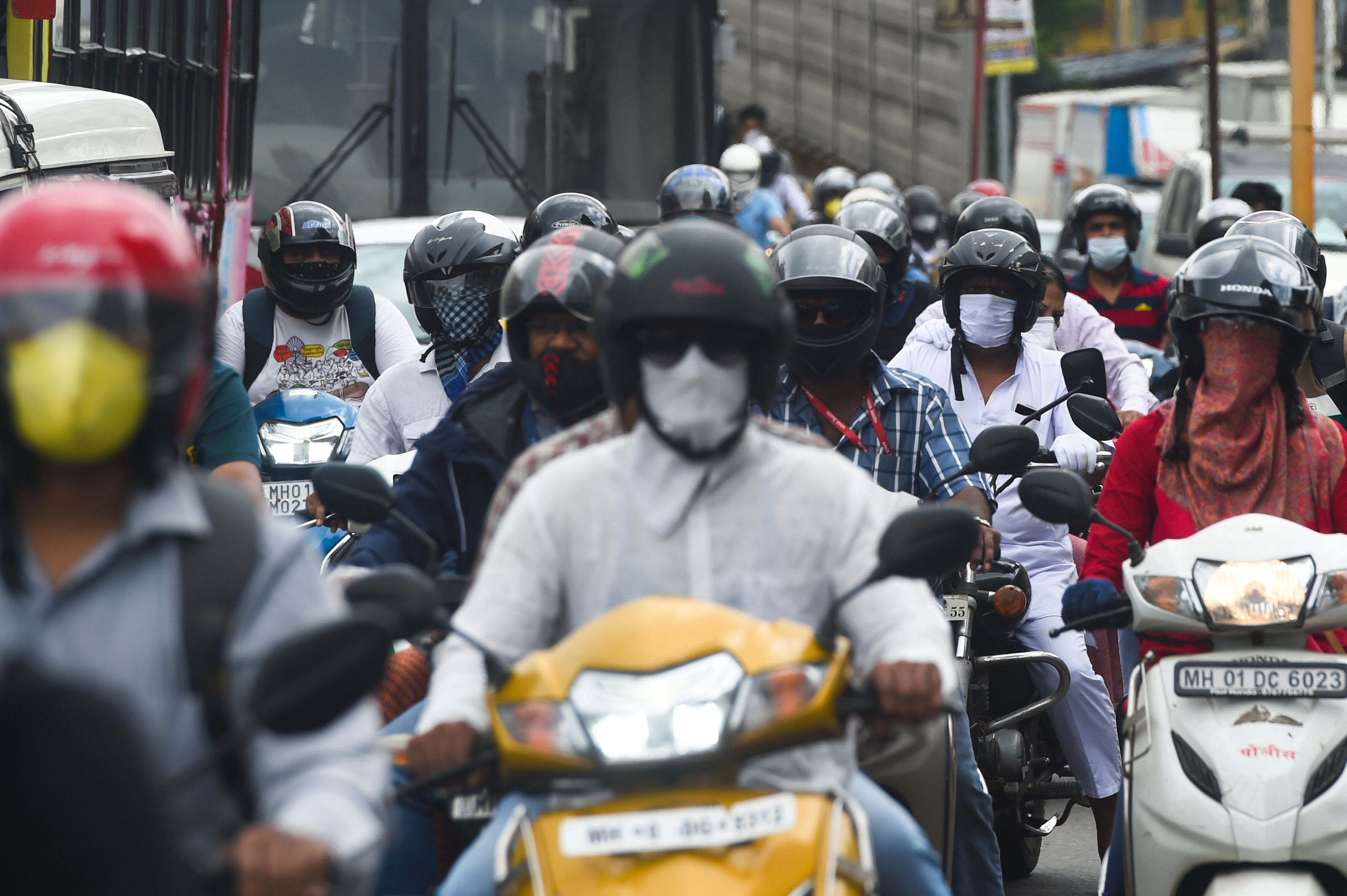 Commuters are seen in a traffic jam during rush hour as places of religious worship, hotels, restaurants and shopping malls are allowed to operate again after more than two months of lockdown imposed as a preventive measure against the COVID-19 coronavirus, in Mumbai on June 8, 2020. (Photo by Punit PARANJPE / AFP) (Photo by PUNIT PARANJPE/AFP via Getty Images)