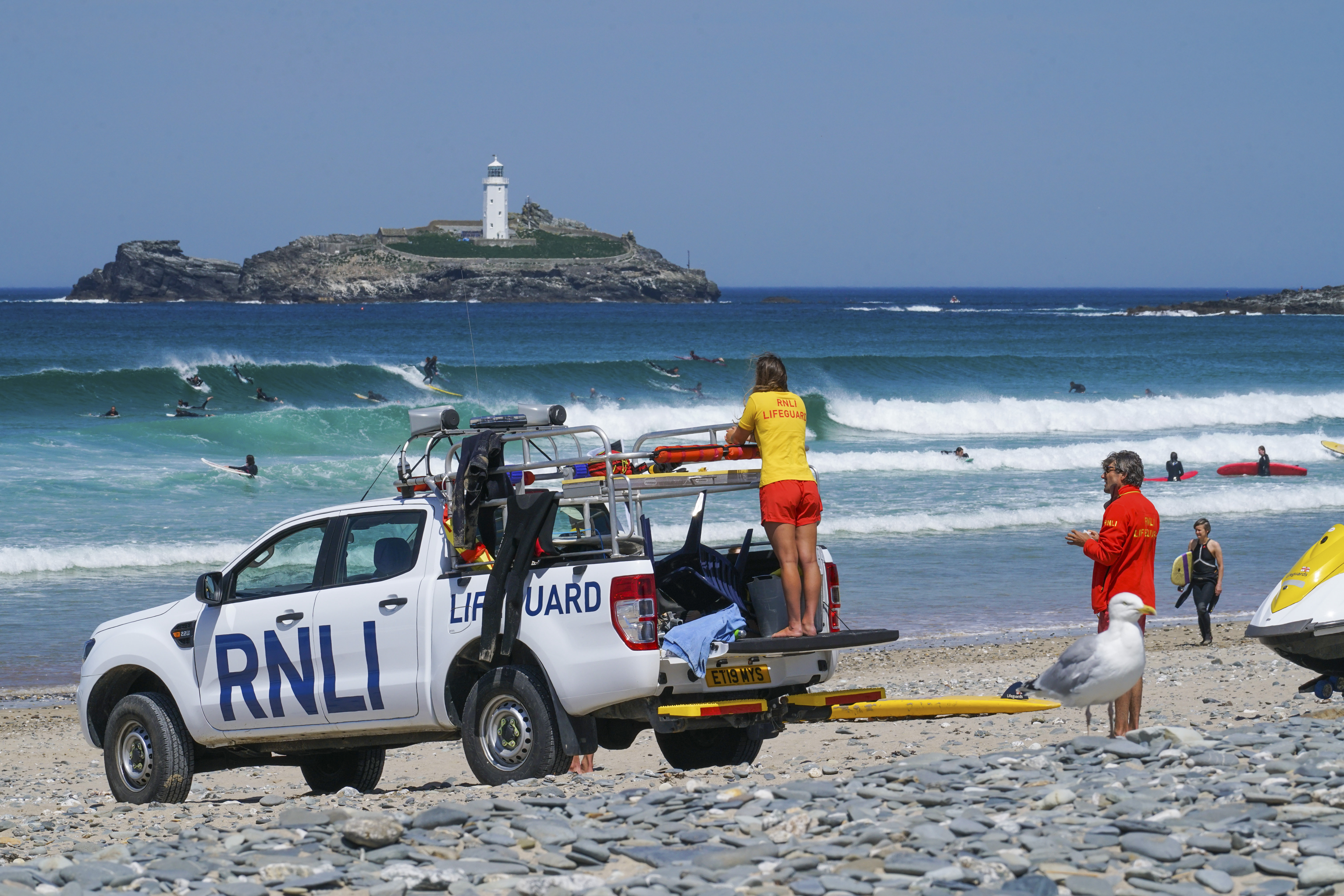 GWITHIAN, HAYLE, UNITED KINGDOM - MAY 31: RNLI lifeguards on duty at Gwithian beach on May 31, 2020 in Gwithian, United Kingdom. Lifeguards returned at Gwithian and six other Cornish beaches this weekend after being absent since the start of the UK Covid-19 lockdown. Cornwall Council has been working with the RNLI to have the cover restored as people flock to beaches in the warm weather. The British government has started easing the lockdown it imposed two months ago to curb the spread of the Covid-19. (Photo by Hugh Hastings/Getty Images)