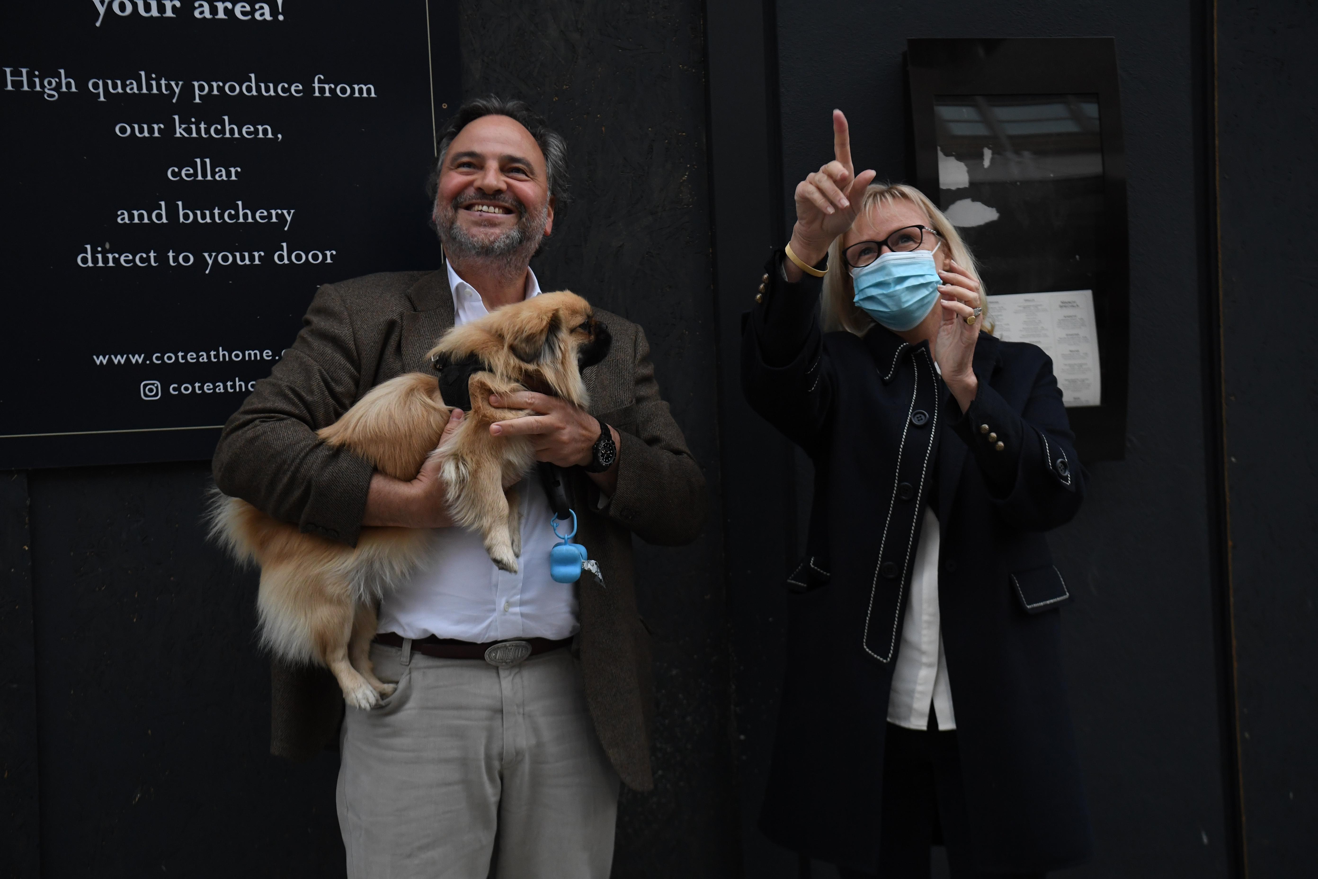 A couple outside the Chelsea and Westminster Hospital, London, join in applause during a Clap for Carers to recognise and support NHS workers and carers fighting the coronavirus pandemic. (Photo by Kirsty O'Connor/PA Images via Getty Images)