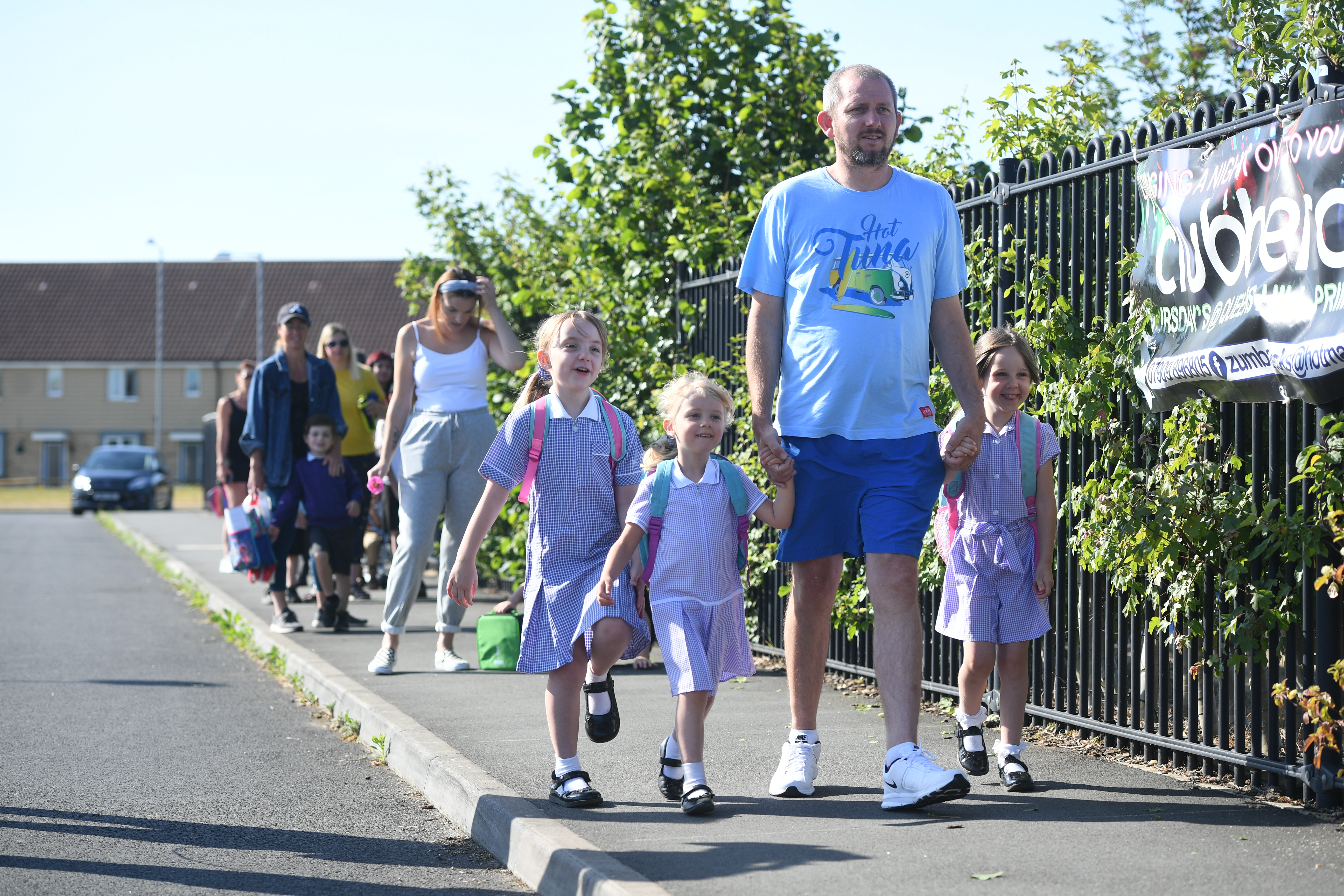 Parents drop off children at Queen's Hill Primary School, Costessey, Norfolk, as pupils in Reception, Year 1 and Year 6, begin to return to school as part of a wider easing of lockdown measures. (Photo by Joe Giddens/PA Images via Getty Images)