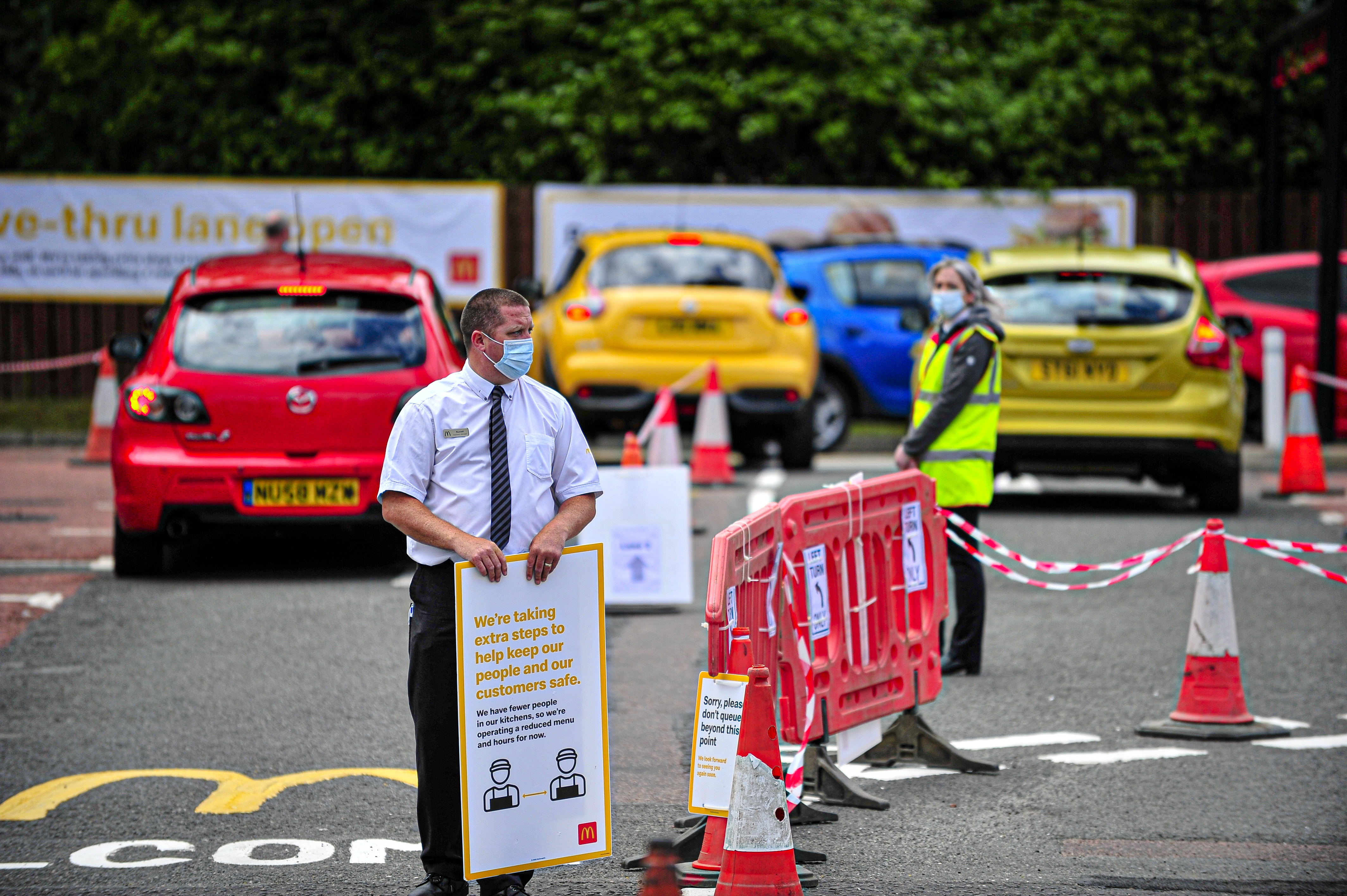 Manager of the branch holding a sign at the car parking during the reopening. McDonald's reopens its Alloa branch on Clackmannan Road as Drive-Thru only and implementing a one-way system to keep the flow of traffic going. (Photo by Stewart Kirby / SOPA Images/Sipa USA)