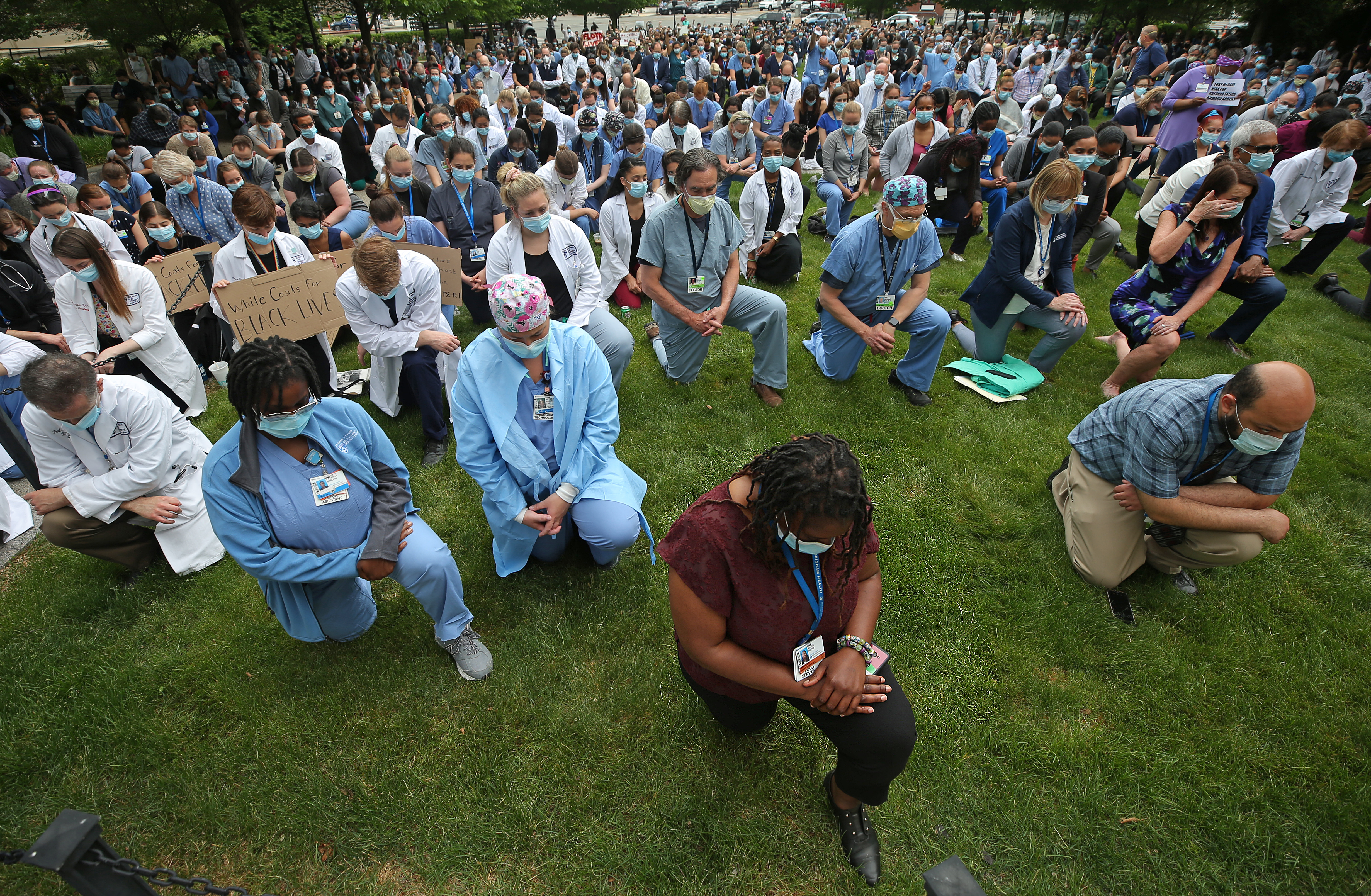 BOSTON, MA - JUNE 7: On the lawn at the Brigham and Women's Hospital in Boston, Members of the Brigham and Women's community kneel during a vigil in memory of George Floyd and reflection on racial injustice on June 5, 2020. (Photo by David L. Ryan/The Boston Globe via Getty Images)