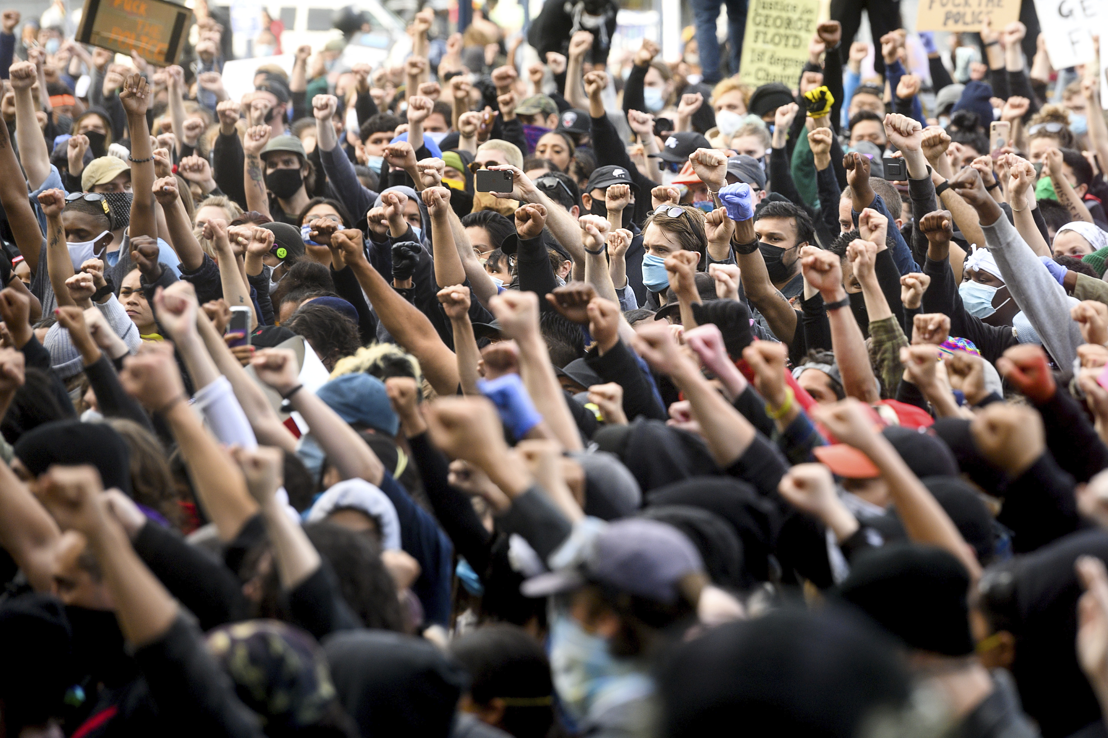 Demonstrators rally in San Francisco on Sunday, May 31, 2020, protesting the death of George Floyd, who died after being restrained by Minneapolis police officers on May 25. (AP Photo/Noah Berger)