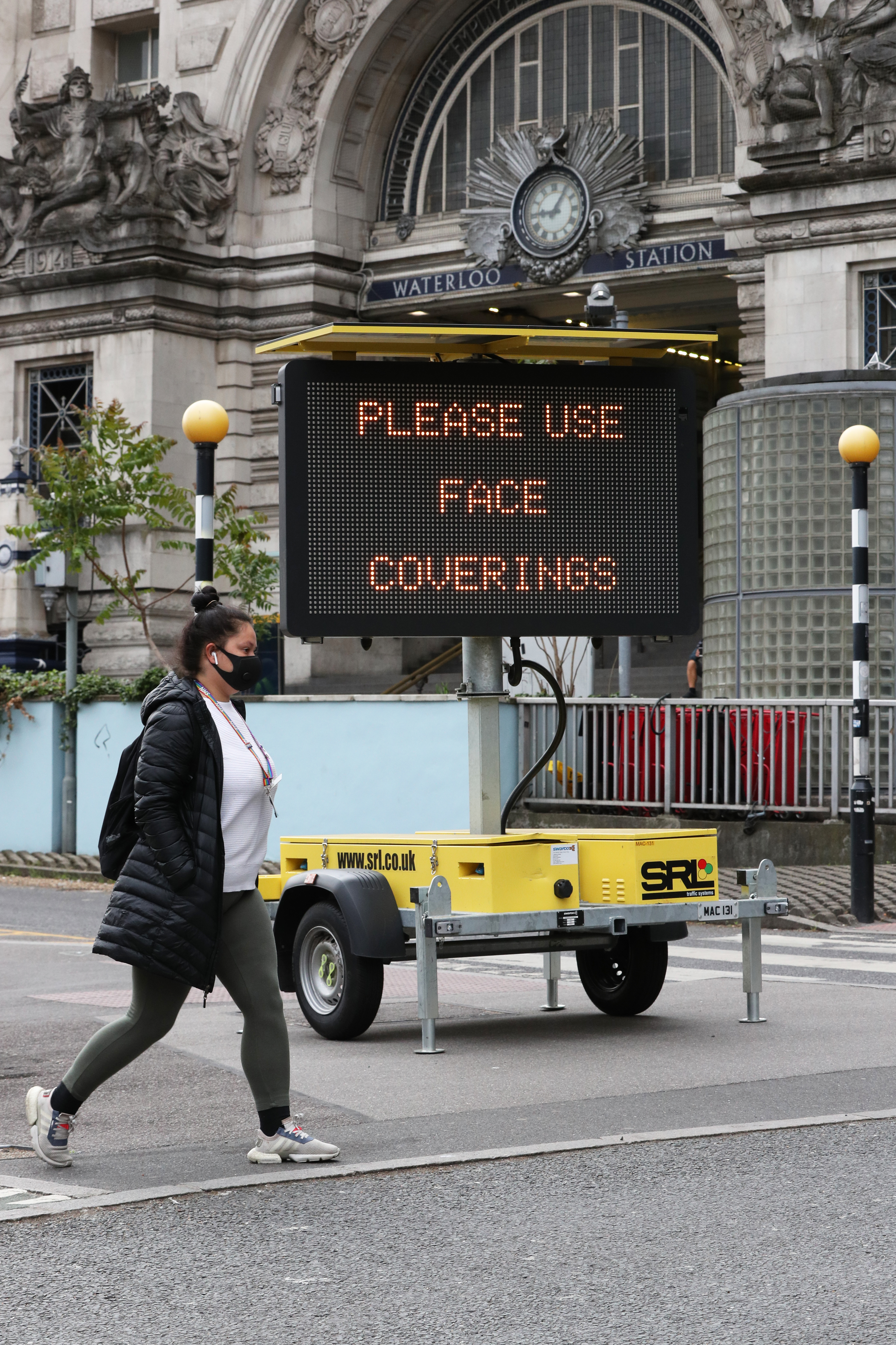 A sign asking people to use face coverings outside Waterloo station in London, following the announcement that wearing a face covering will be mandatory for passengers on public transport in England from June 15. (Photo by Jonathan Brady/PA Images via Getty Images)