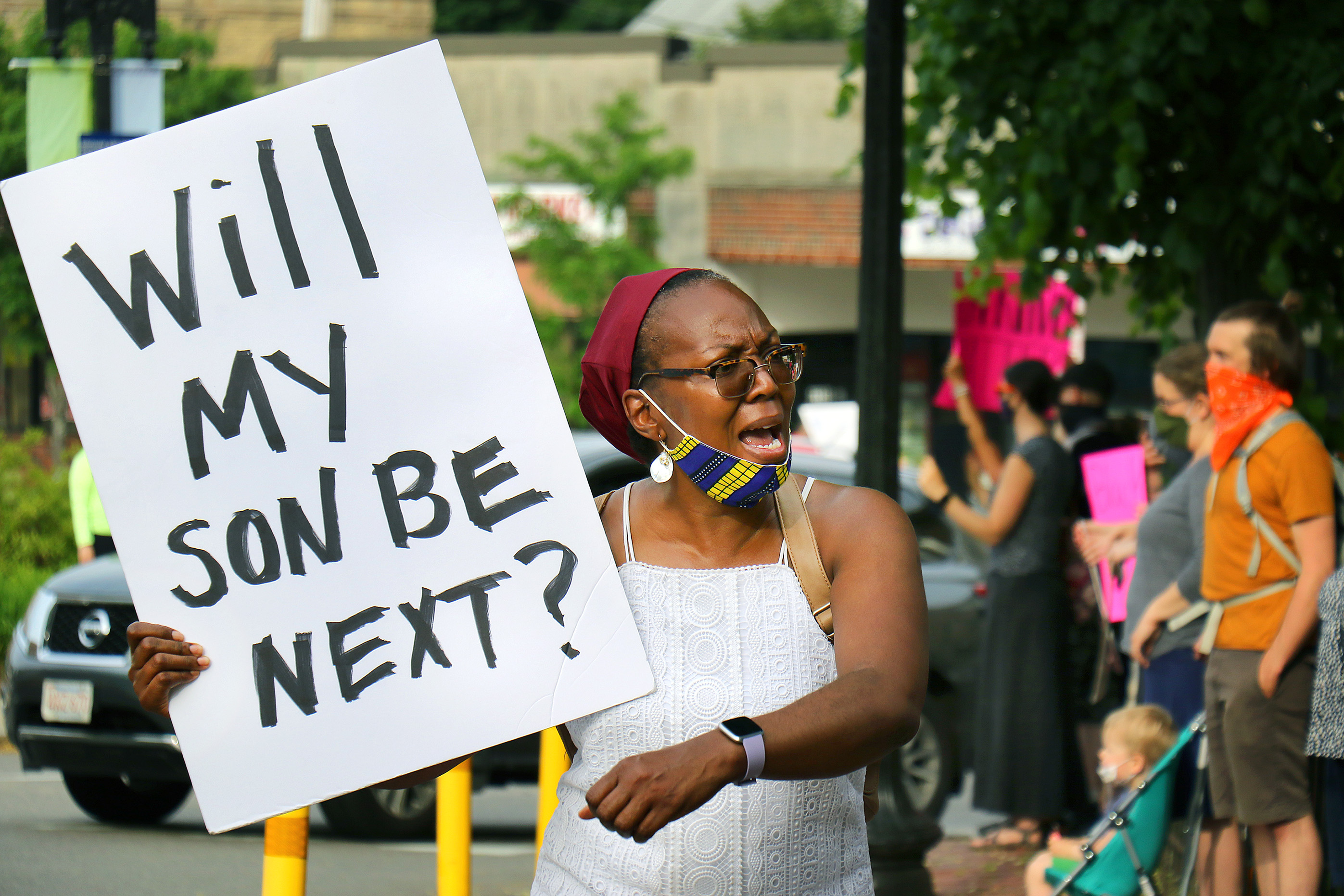 """BOSTON, MA - JUNE 4: Leandrea Brantle from Roslindale holds a sign asking """"Will my son be next?"""" at A Silent Vigil for Black Lives in Adams Park in Boston on June 4, 2020. Protesters gather calling for justice for George Floyd and other Black Americans killed by police officers on the day of Floyd's funeral. (Photo by John Tlumacki/The Boston Globe via Getty Images)"""