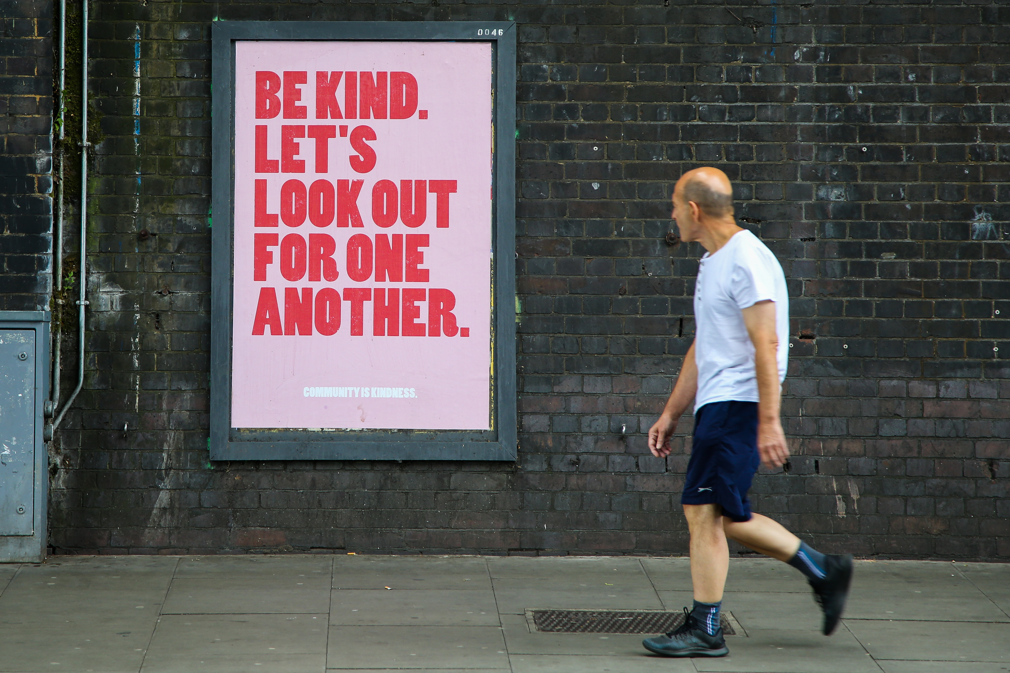 A man walks past a Be kind. Let's look out for one another poster in London. (Photo by Dinendra Haria / SOPA Images/Sipa USA)