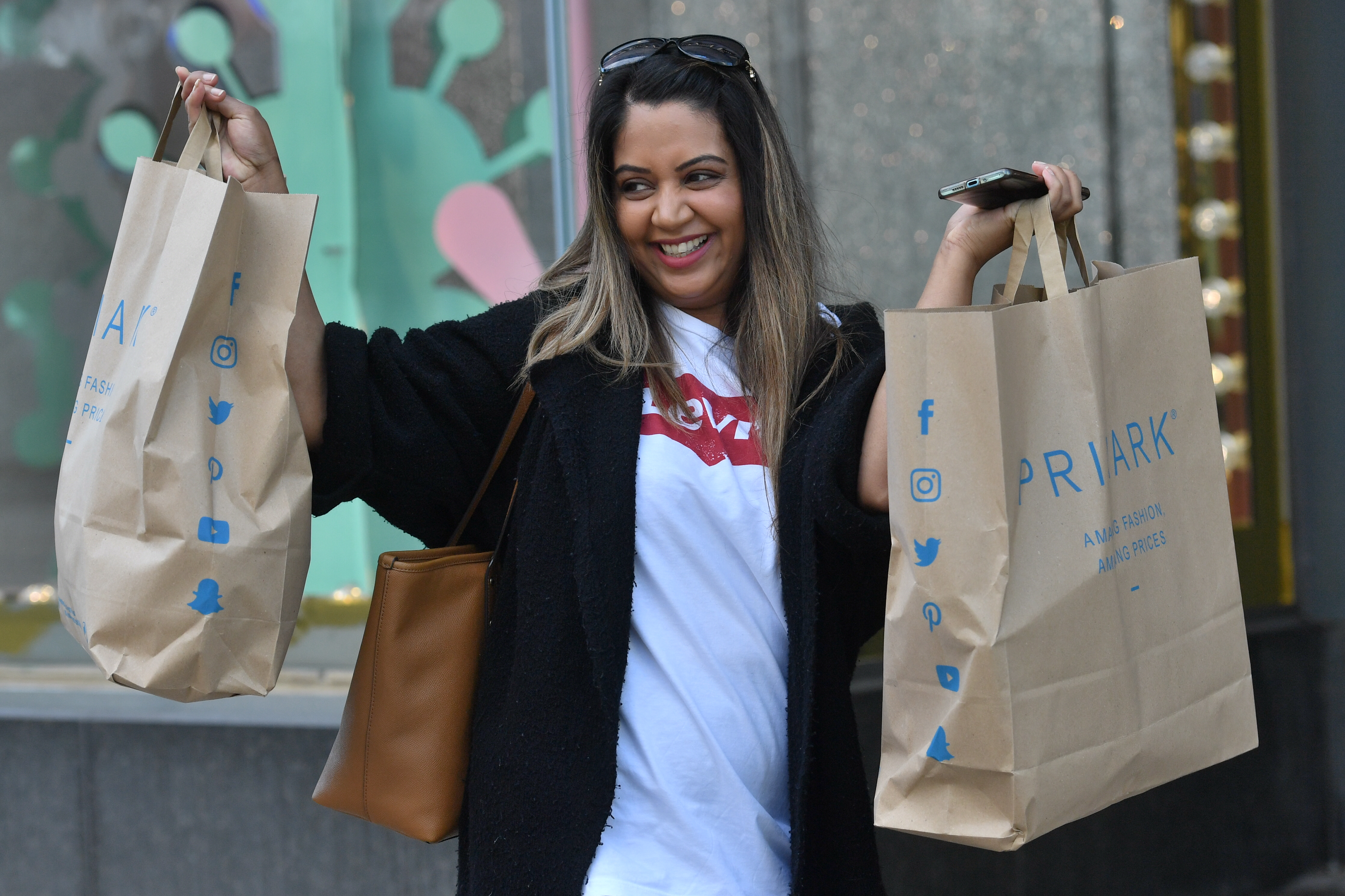A customer carrying bags of shopping leaves Primark in Birmingham as non-essential shops in England open their doors to customers for the first time since coronavirus lockdown restrictions were imposed in March. (Photo by Jacob King/PA Images via Getty Images)