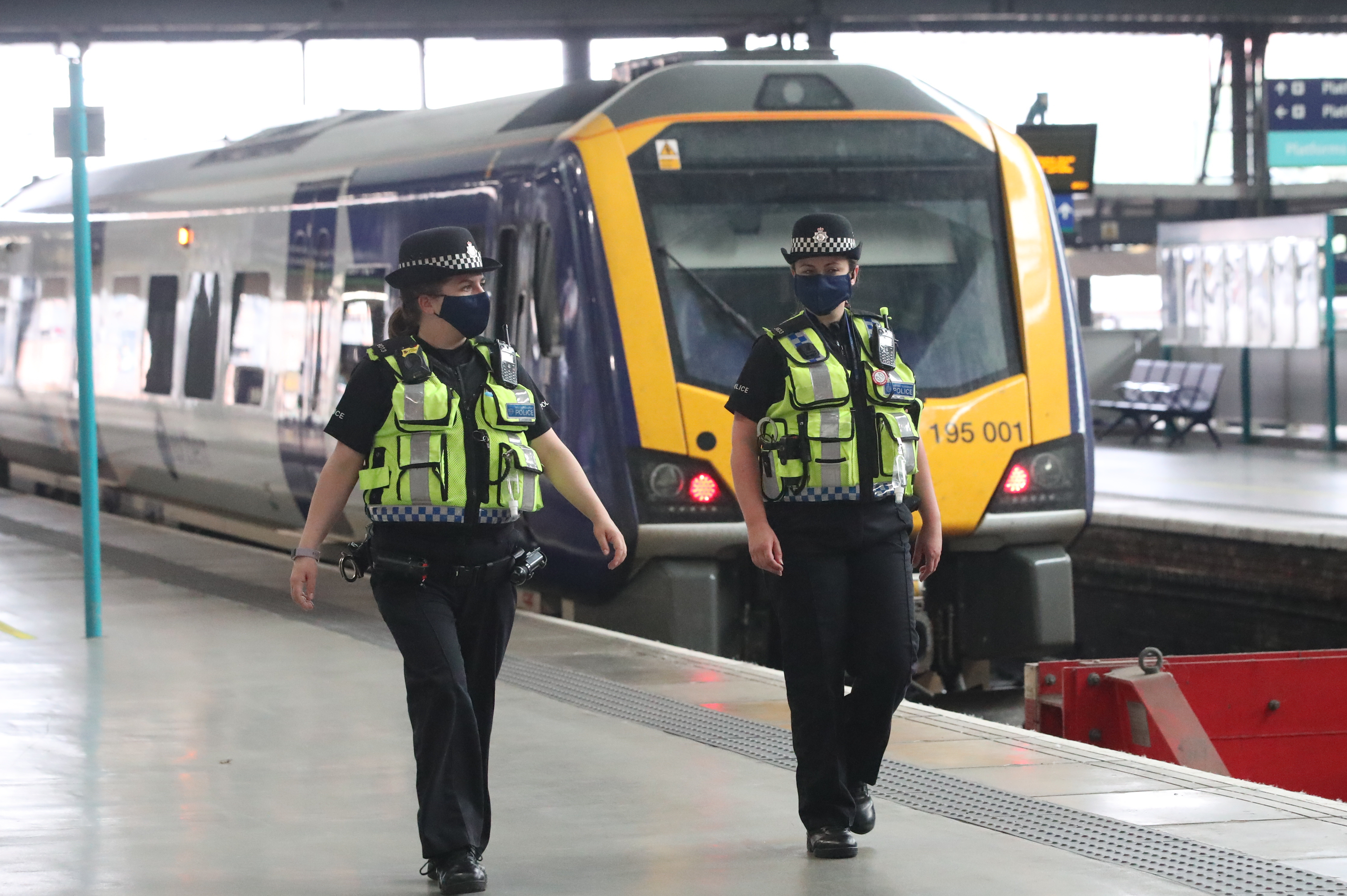 Police officers wearing face masks at Leeds railway station as face coverings become mandatory on public transport in England with the easing of further lockdown restrictions during the coronavirus pandemic. (Photo by Danny Lawson/PA Images via Getty Images)