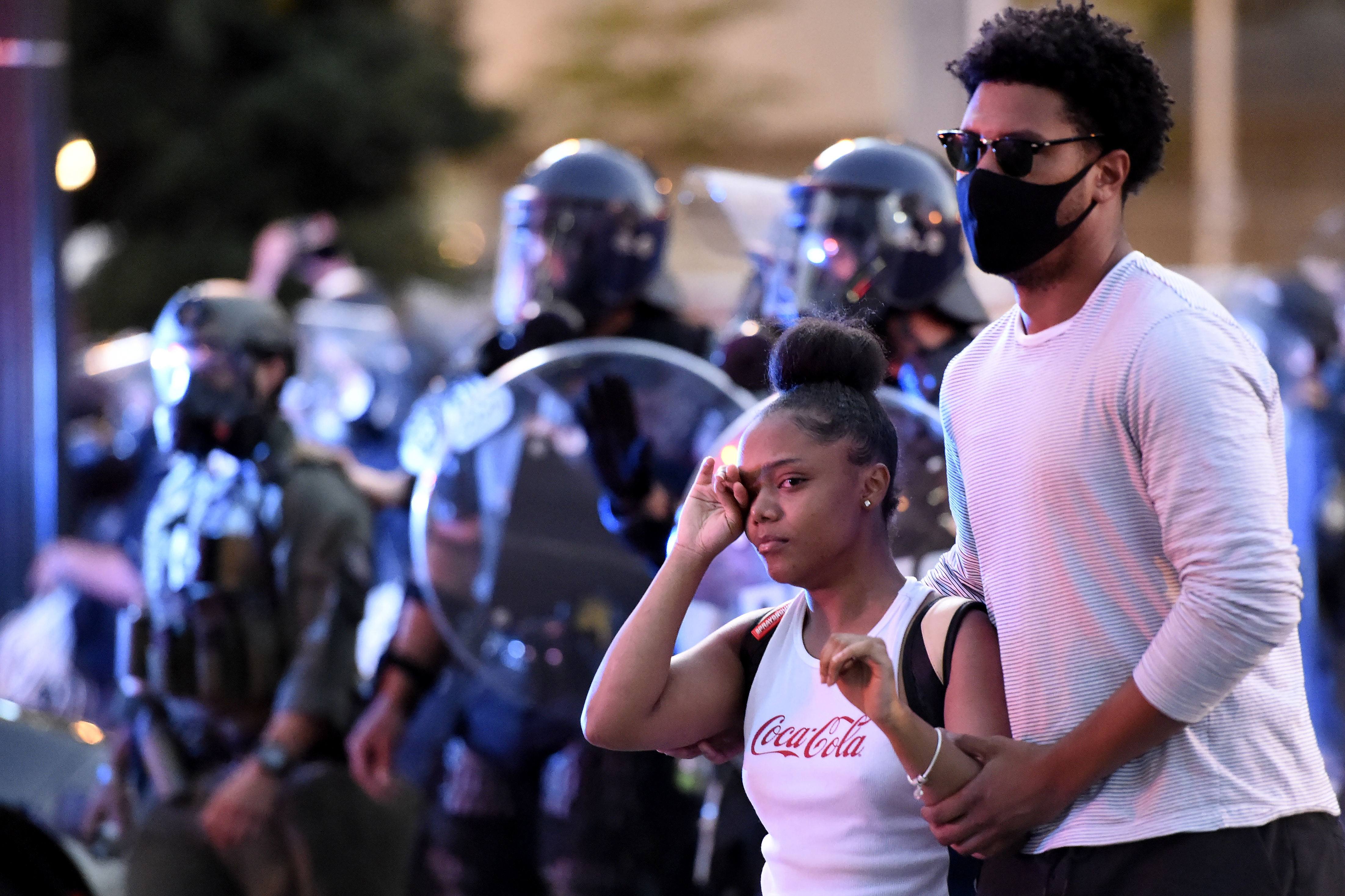 Demonstrators march, Sunday, May 31, 2020, in Atlanta. Protests continued following the death of George Floyd, who died after being restrained by Minneapolis police officers on May 25. (AP Photo/Mike Stewart)