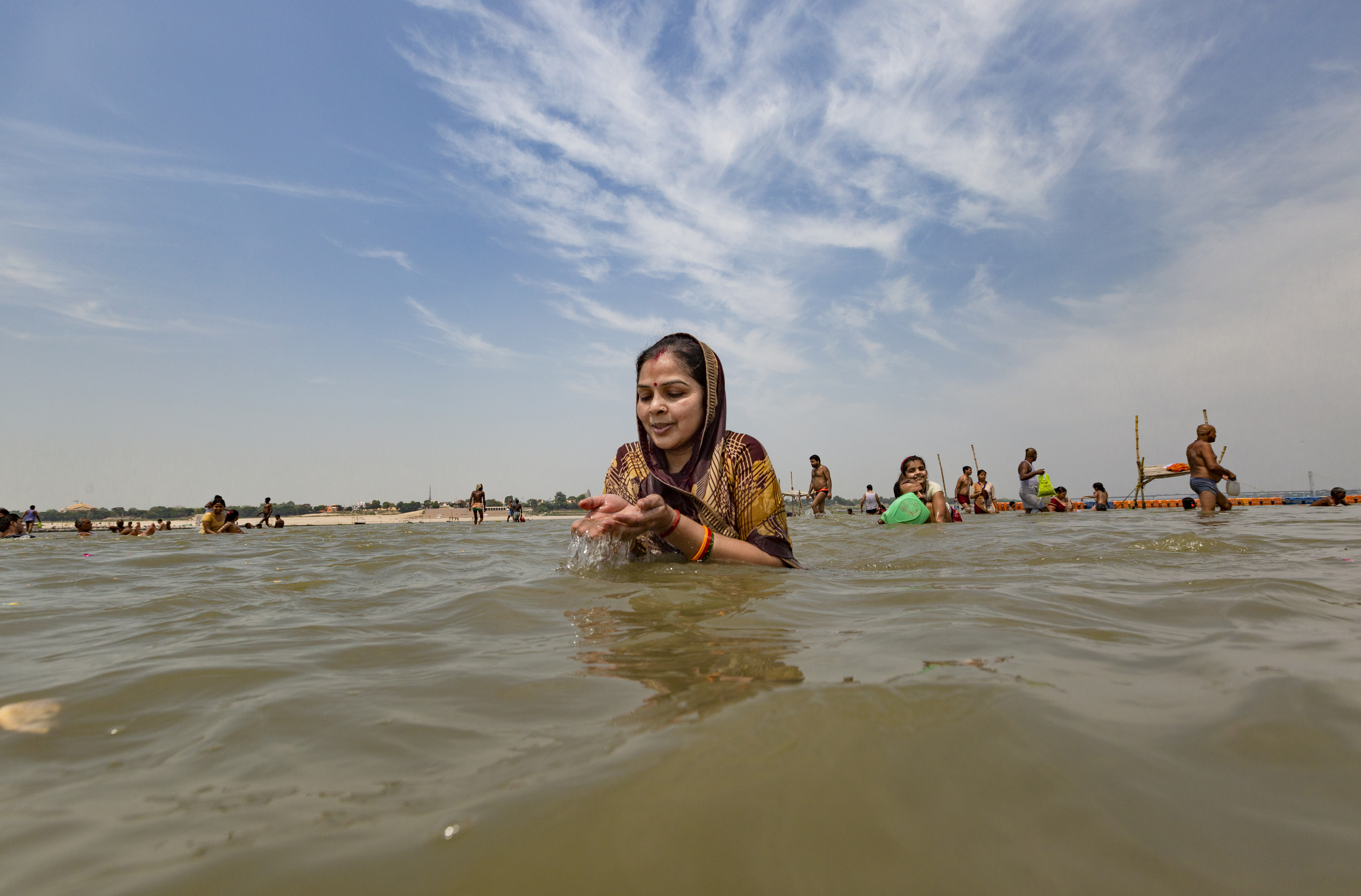 A Hindu devotee offers prayers in the River Ganges, during the Ganga Dussehra festival, in Prayagraj, India, Monday, June 1, 2020. Hundreds of Hindu devotees made holy dips here Monday even though congregations at religious venues continue to remain barred during the nationwide coronavirus lockdown. (AP Photo/Rajesh Kumar Singh)