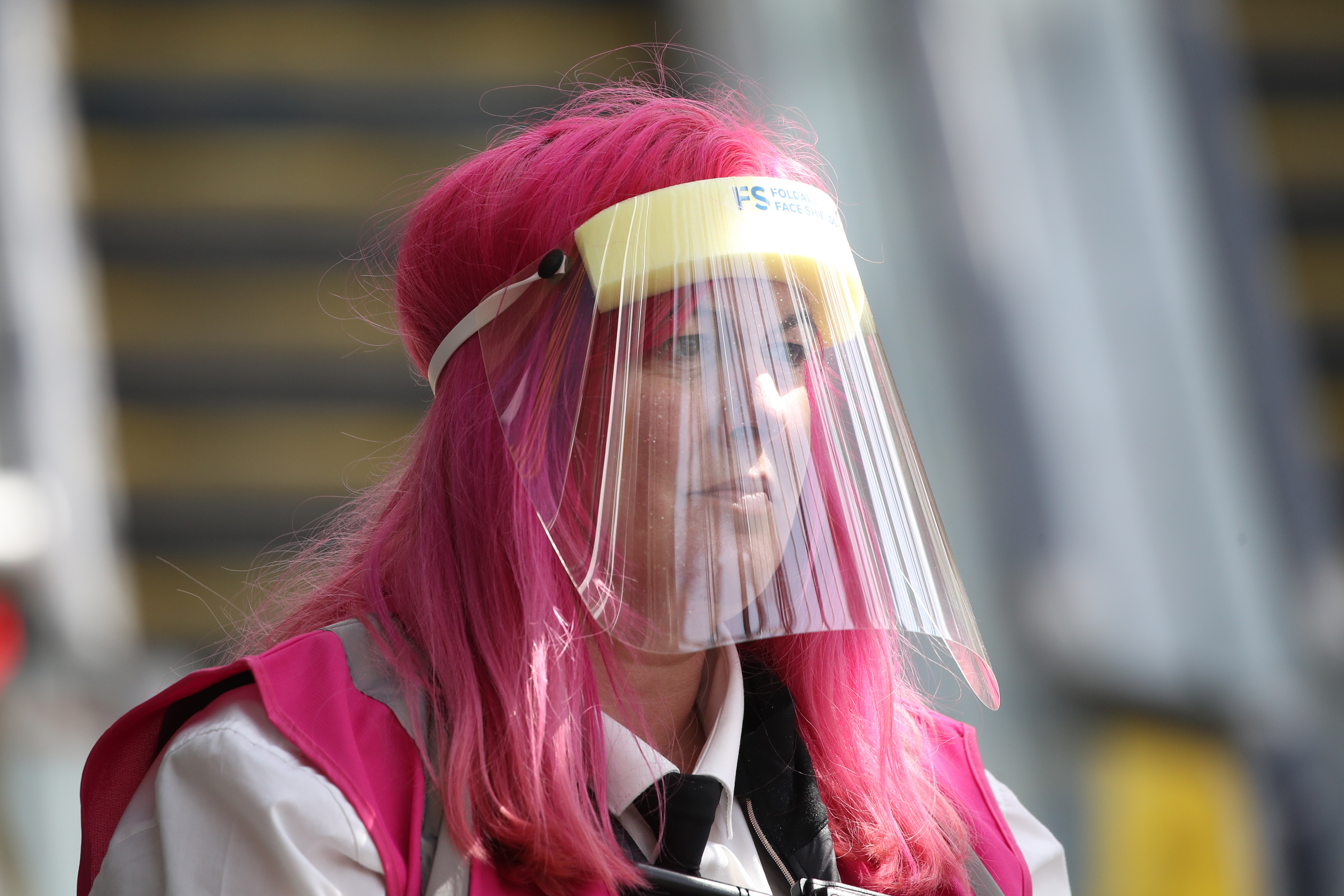 A customer service assistant at Edinburgh Waverley Station wears a protective mask as Scotland moves into phase one of the Scottish Government's plan for gradually lifting lockdown. (Photo by Andrew Milligan/PA Images via Getty Images)
