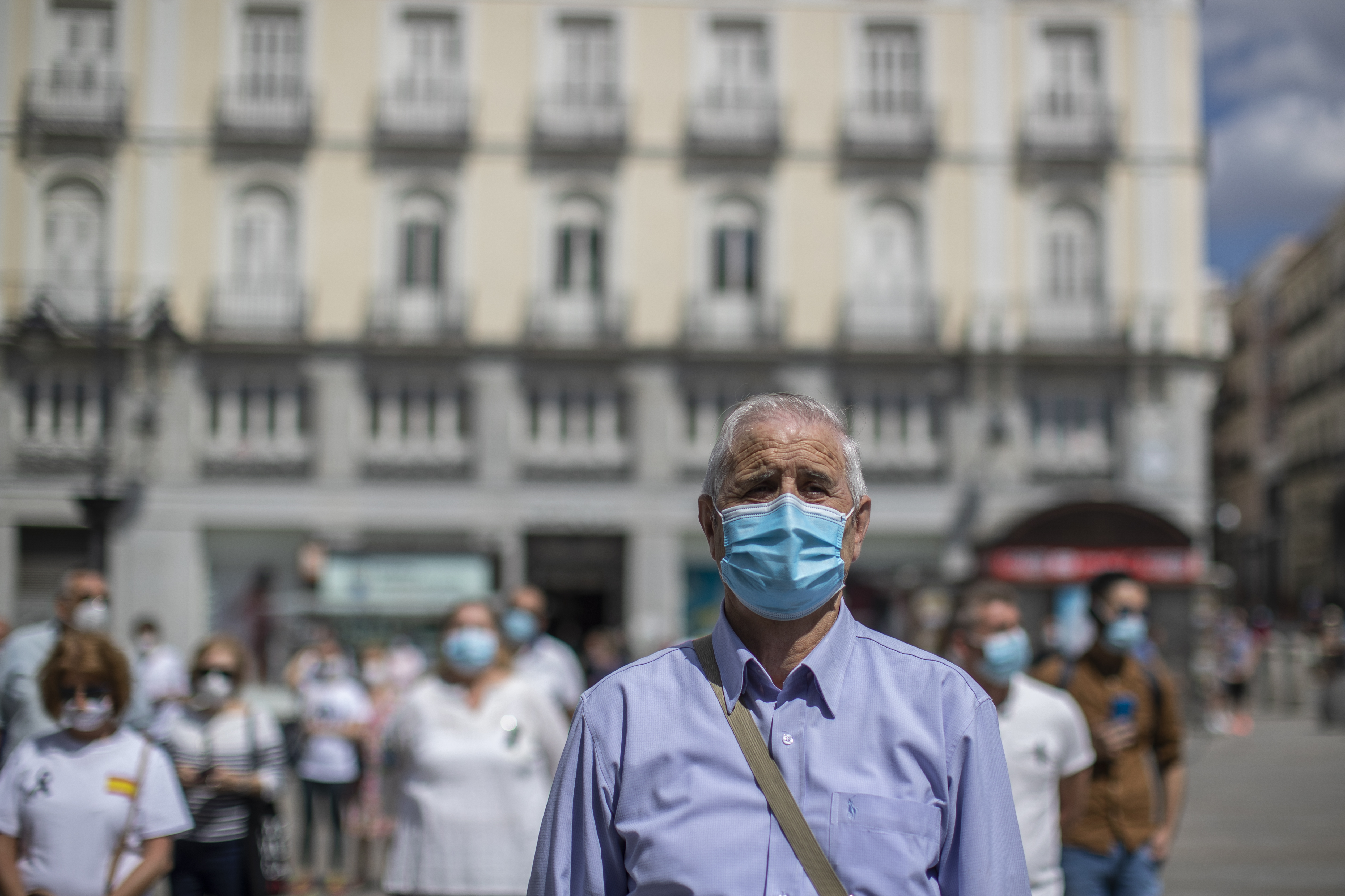People hold a minute of silence for the victims of COVID-19 at Sol square in downtown Madrid, Spain, Wednesday, June 3, 2020. Spain's Health Ministry says it recorded no deaths from COVID-19 Wednesday for a second day in a row. (AP Photo/Manu Fernandez)