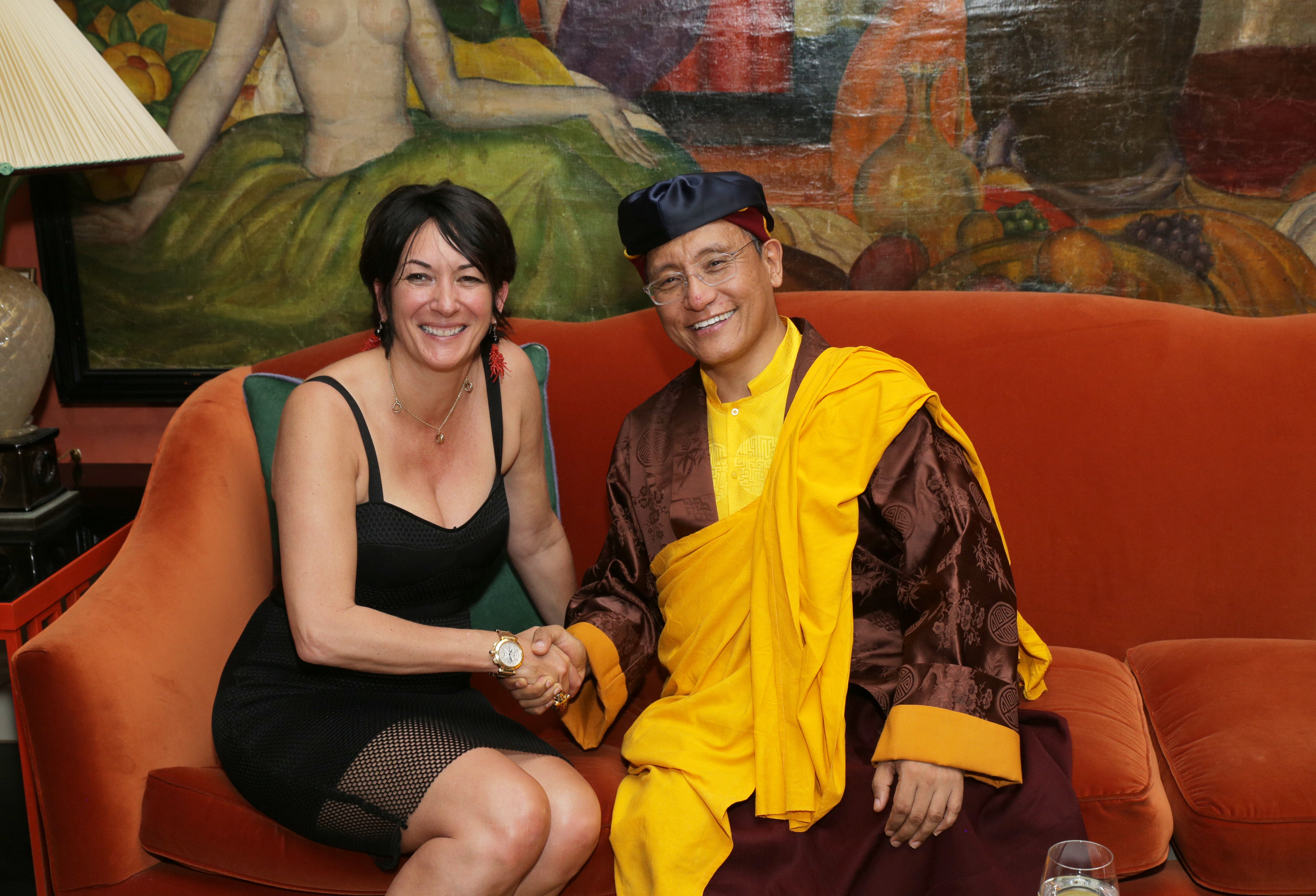 """NEW YORK, NY - JUNE 05: TerraMar's Ghislaine Maxwell (L) and his holiness the Gyalwang Drukpa attend a reception at Ghislaine Maxwell's residence after """"StarTalk Live! Water World"""" Panel Discussion on June 5, 2014 in New York City. (Photo by Andrew Toth/Getty Images)"""