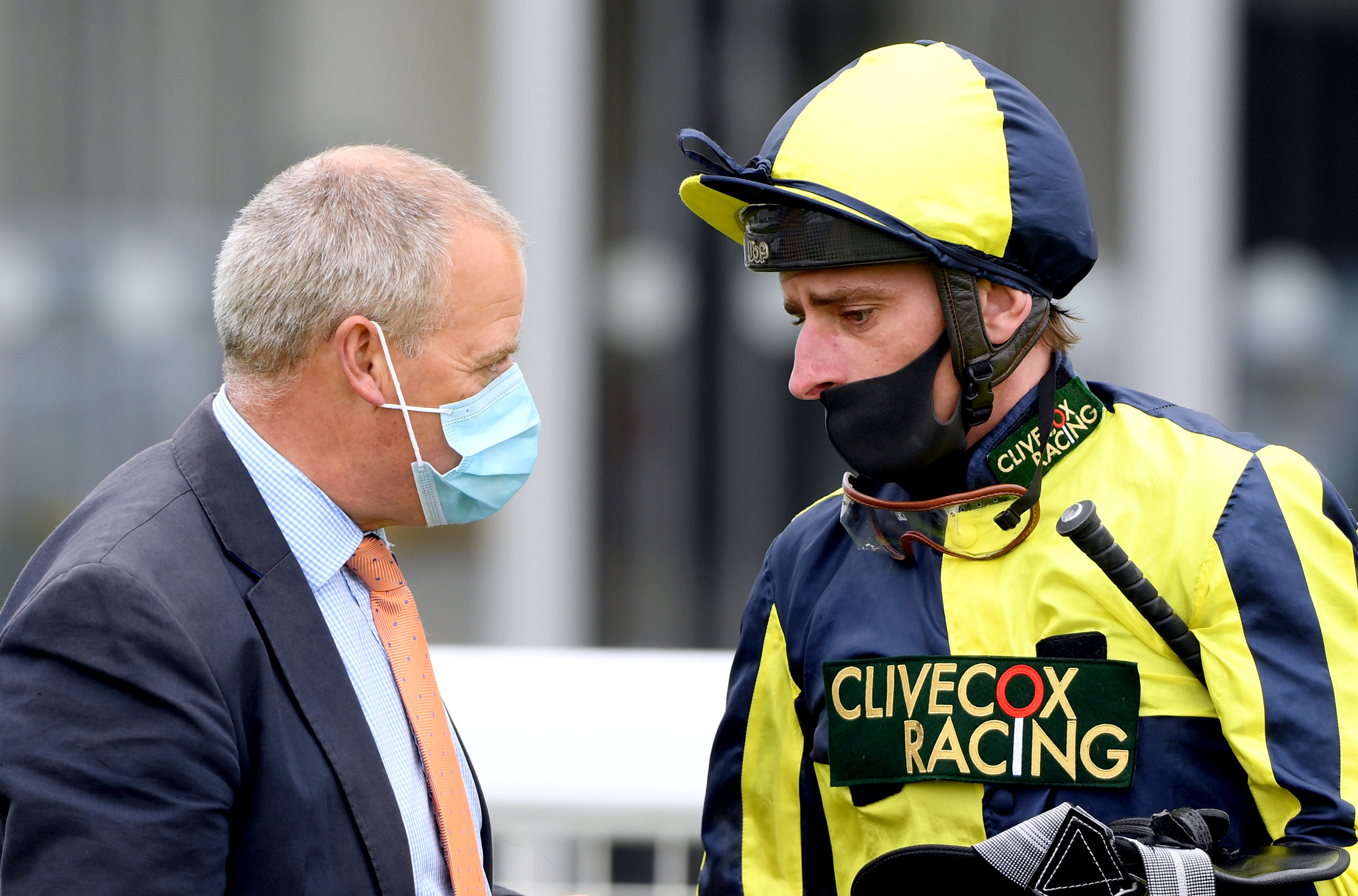 Jockey Adam Kirby (right) speaks to horse trainer Clive Cox after wining the Home Of Winners At valuerater.co.uk Handicap (Div 2) with Willy Nilly at Bath Racecourse.