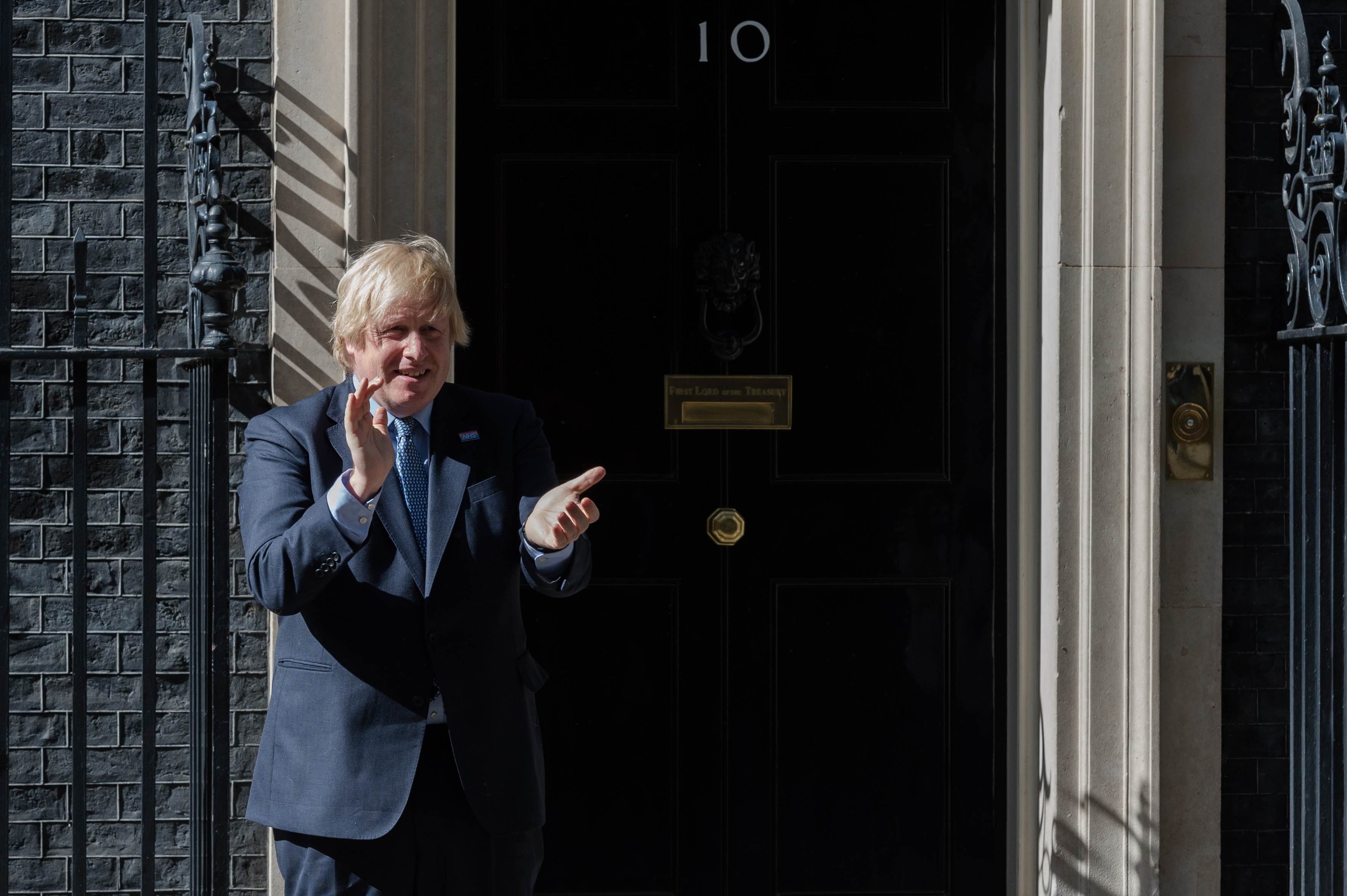 British Prime Minister Boris Johnson claps hands outside 10 Downing Street during the nationwide applause for the NHS staff on the 72nd anniversary of the launch of the National Health Service on 05 July, 2020 in London, England. (Photo by WIktor Szymanowicz/NurPhoto via Getty Images)