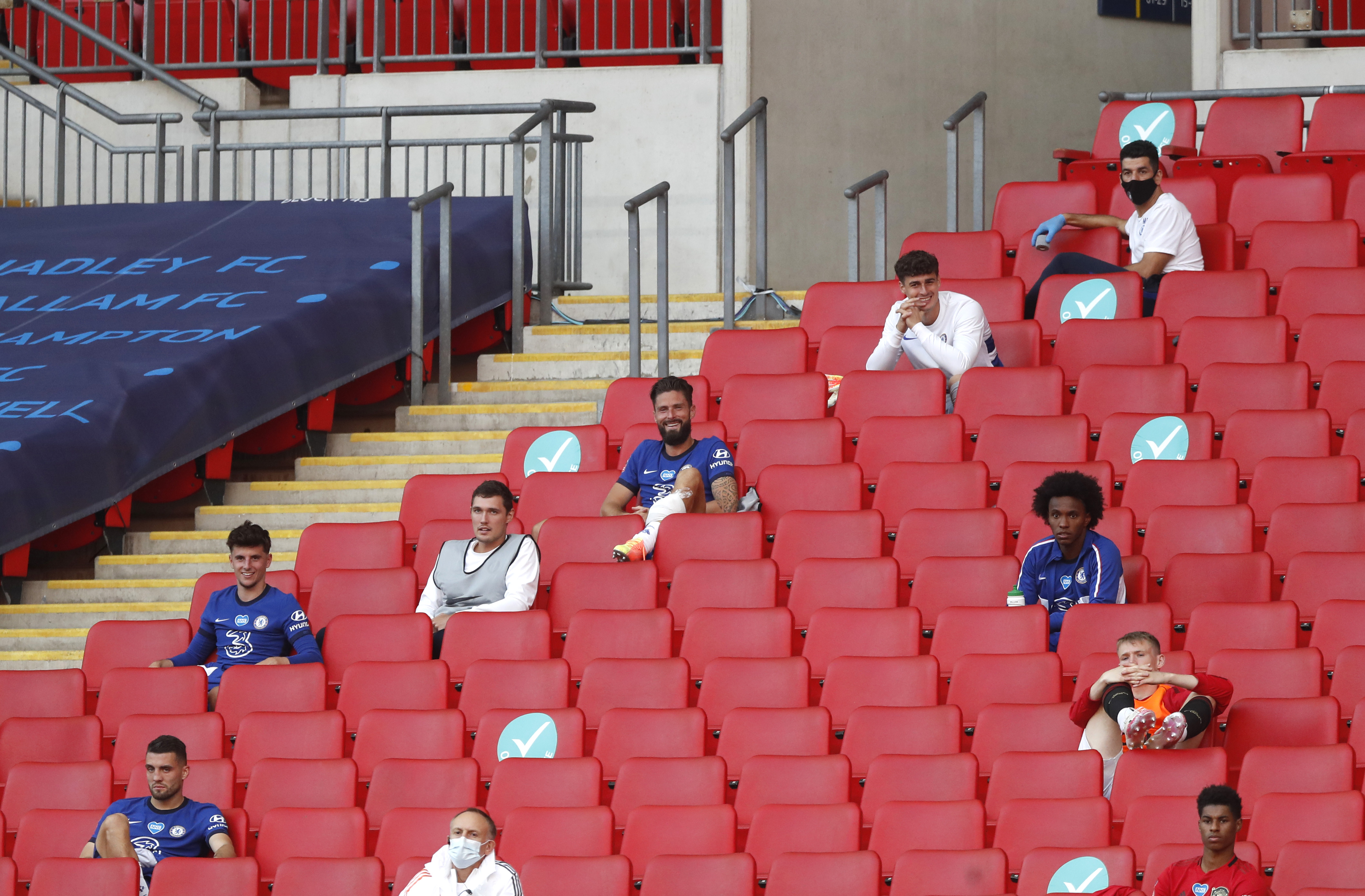 LONDON, ENGLAND - JULY 19: Olivier Giroud of Chelsea sits on the bench during the FA Cup Semi Final match between Manchester United and Chelsea at Wembley Stadium on July 19, 2020 in London, England. Football Stadiums around Europe remain empty due to the Coronavirus Pandemic as Government social distancing laws prohibit fans inside venues resulting in all fixtures being played behind closed doors. (Photo by Alastair Grant/Pool via Getty Images)