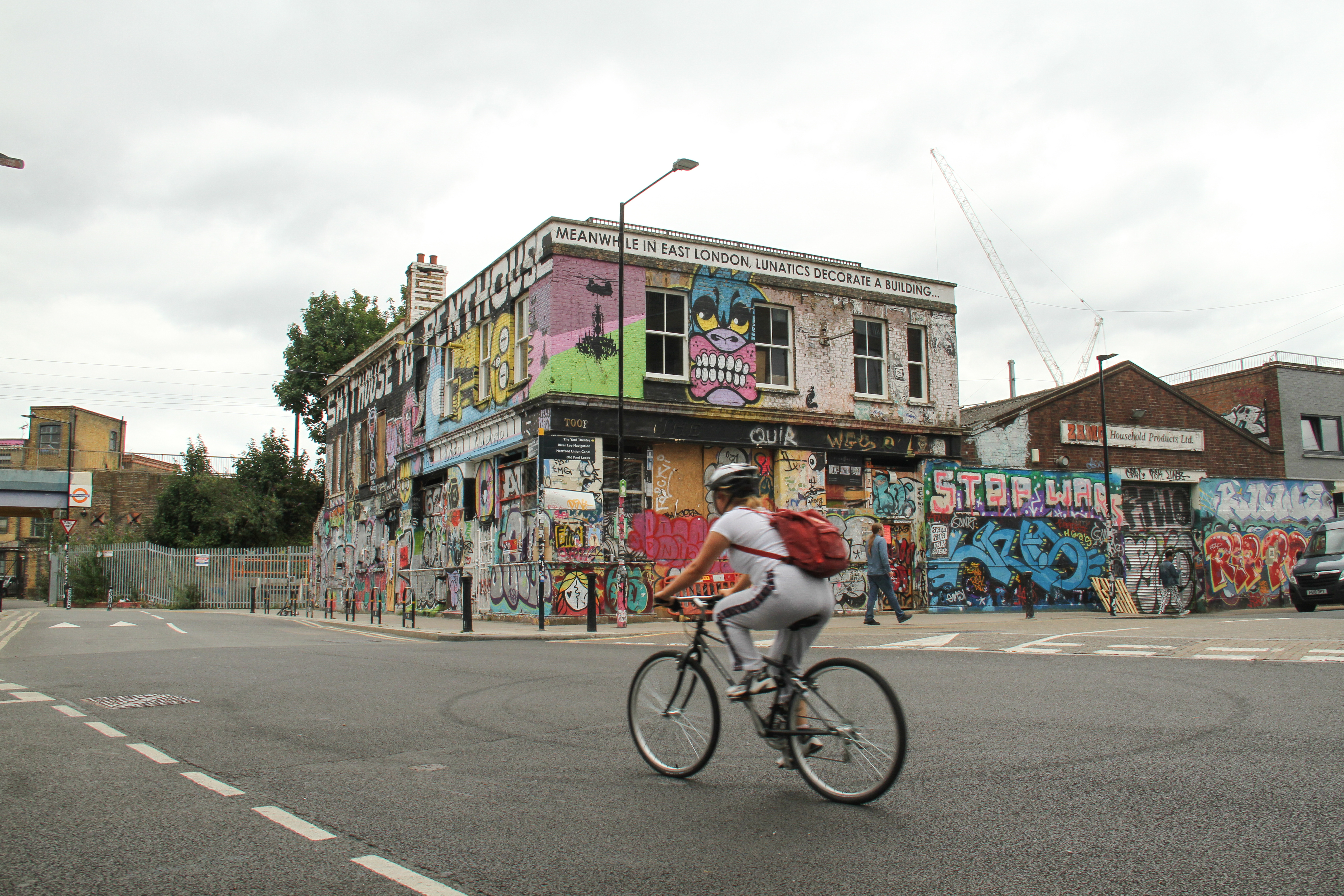 A cyclist ride past a derelict building on Hepscott Rd, Hackney Wick. Despite the reopening of �non-essential� shops, parks and some leisure facilities, numbers of shoppers were still lower than usual as the public opt to purchase online and work from home. (Photo by David Mbiyu / SOPA Images/Sipa USA)