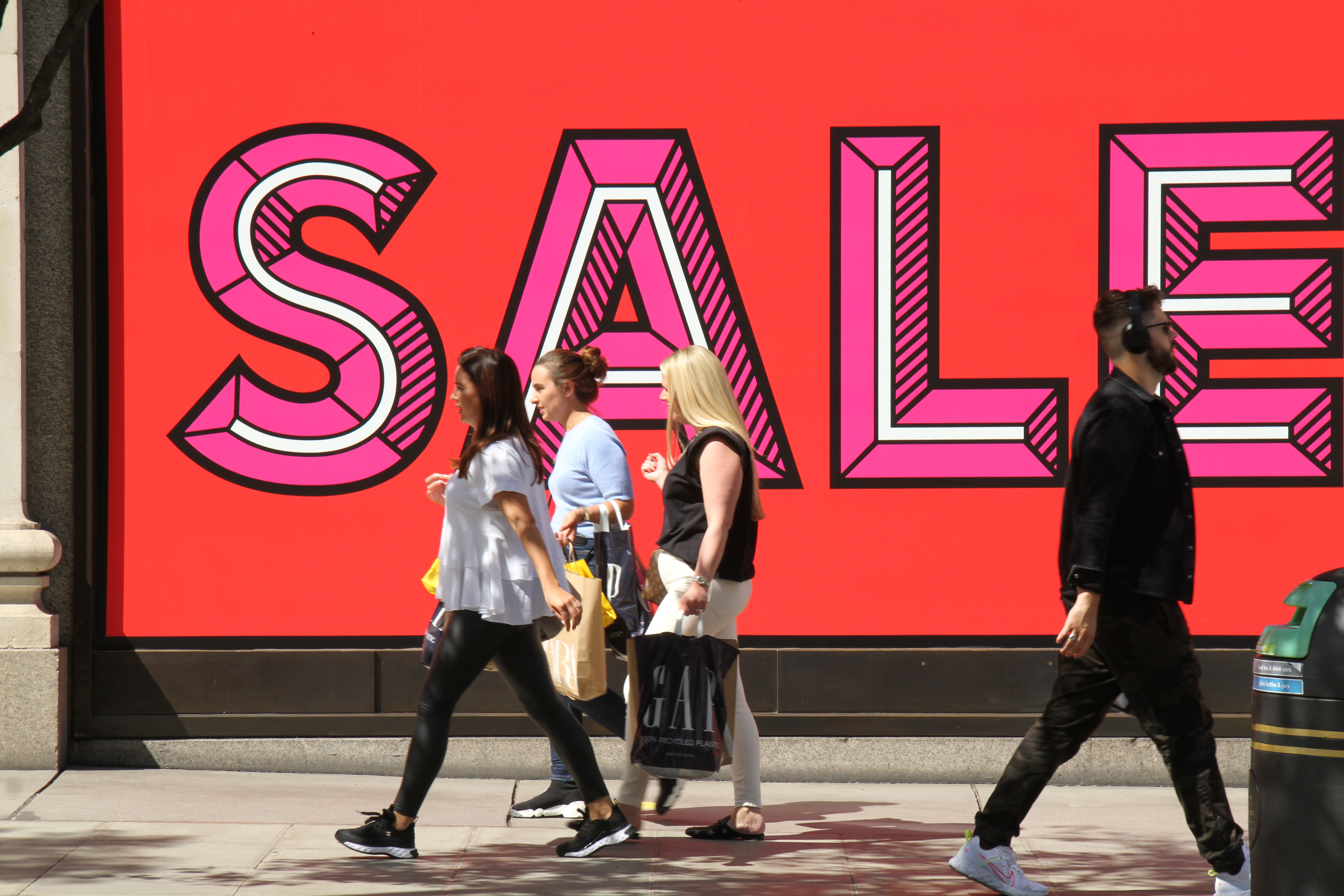 Shoppers walk past a SALE sign at the Sefrdiges store amid coronavirus crisis. Londoners have slowly began to go back to 'normal' with shops reopened on Oxford Street. This week the government has advised on the opening of gyms and pools from 11 July. (Photo by David Mbiyu / SOPA Images/Sipa USA)