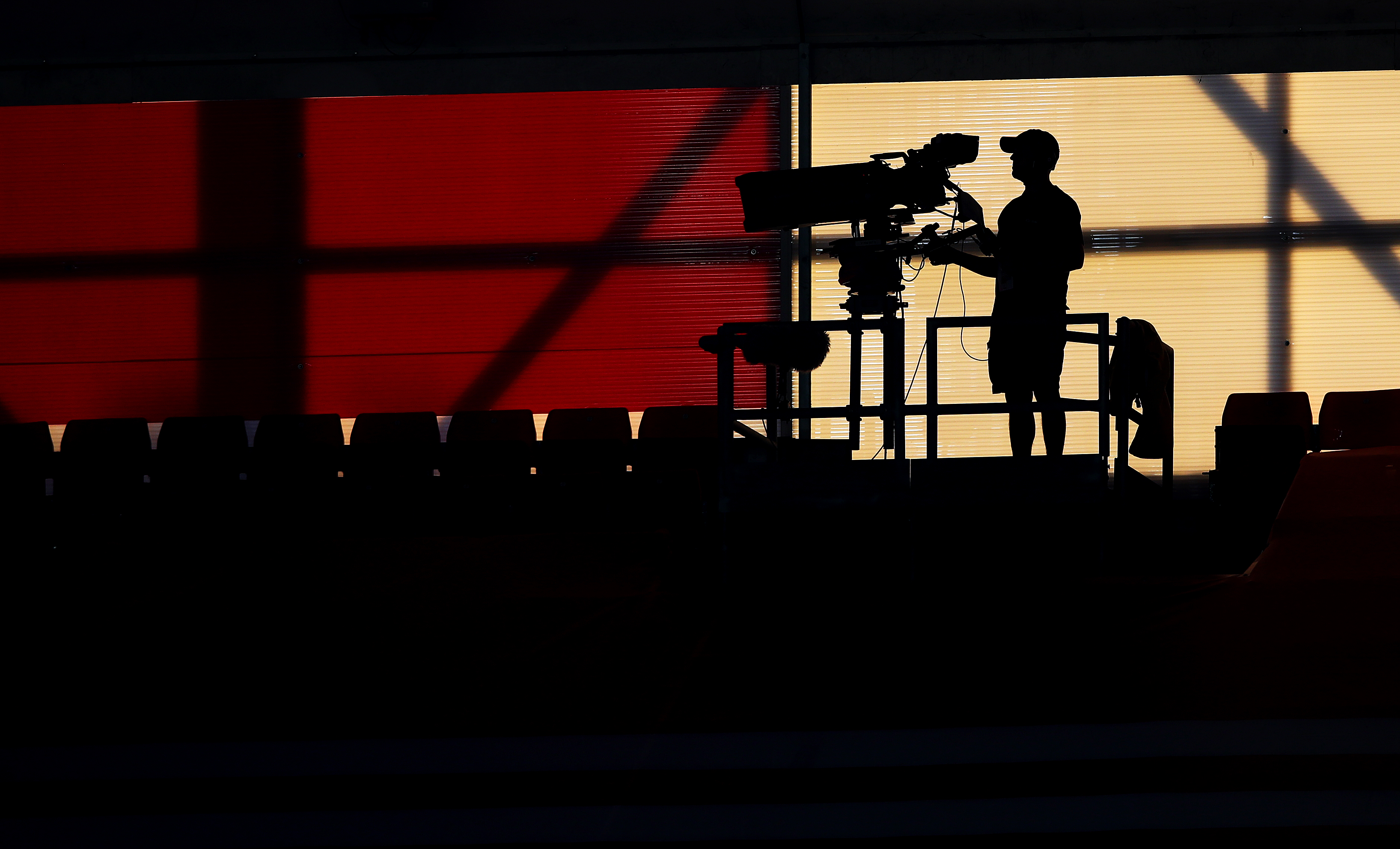 SOUTHAMPTON, ENGLAND - JULY 16: A TV camera operator works during the Premier League match between Southampton FC and Brighton & Hove Albion at St Mary's Stadium on July 16, 2020 in Southampton, United Kingdom. Football Stadiums around Europe remain empty due to the Coronavirus Pandemic as Government social distancing laws prohibit fans inside venues resulting in all fixtures being played behind closed doors. (Photo by Matt Watson/Southampton FC via Getty Images)
