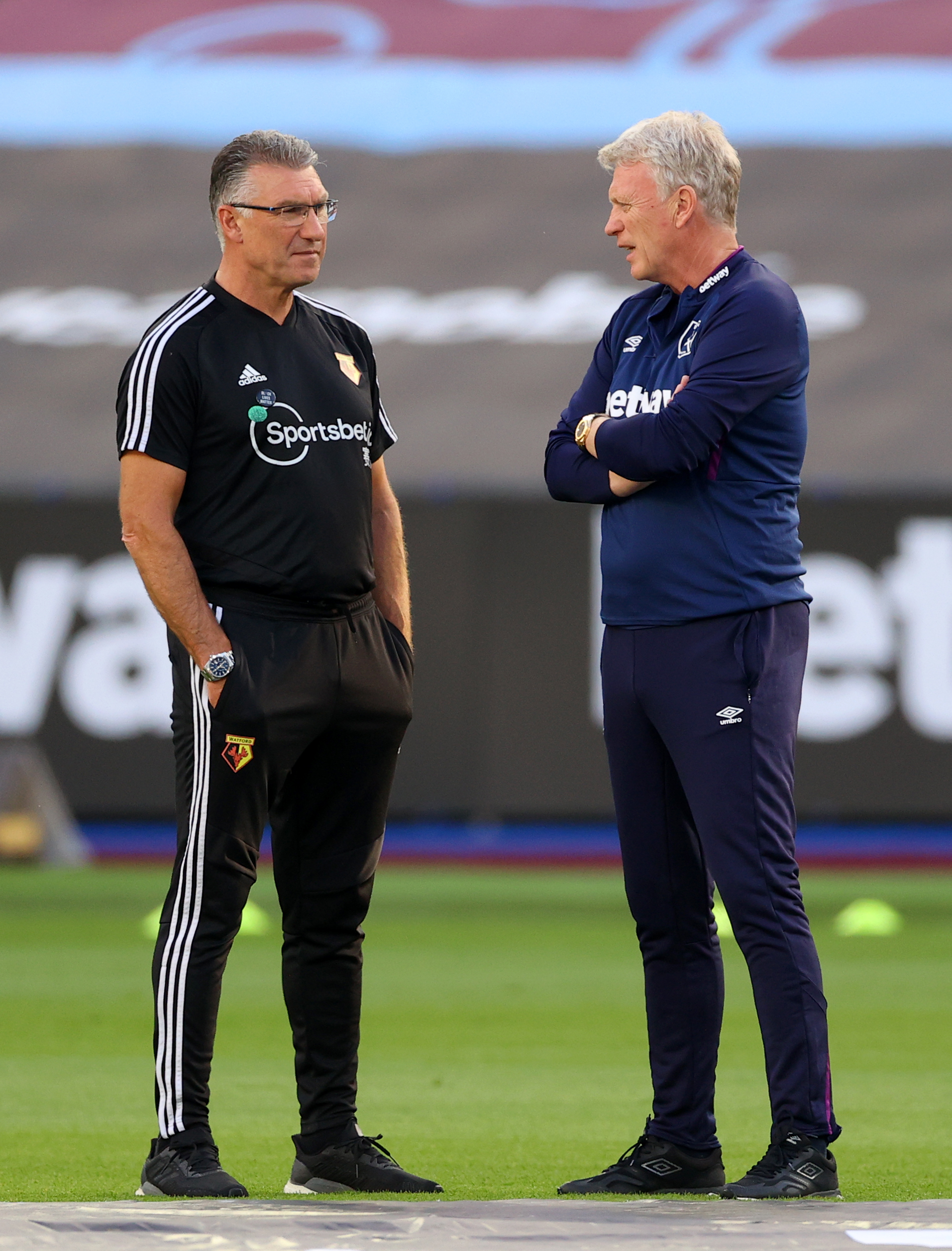 Watford manager Nigel Pearson (left) and West Ham United manager David Moyes speak prior to the Premier League match at the London Stadium.
