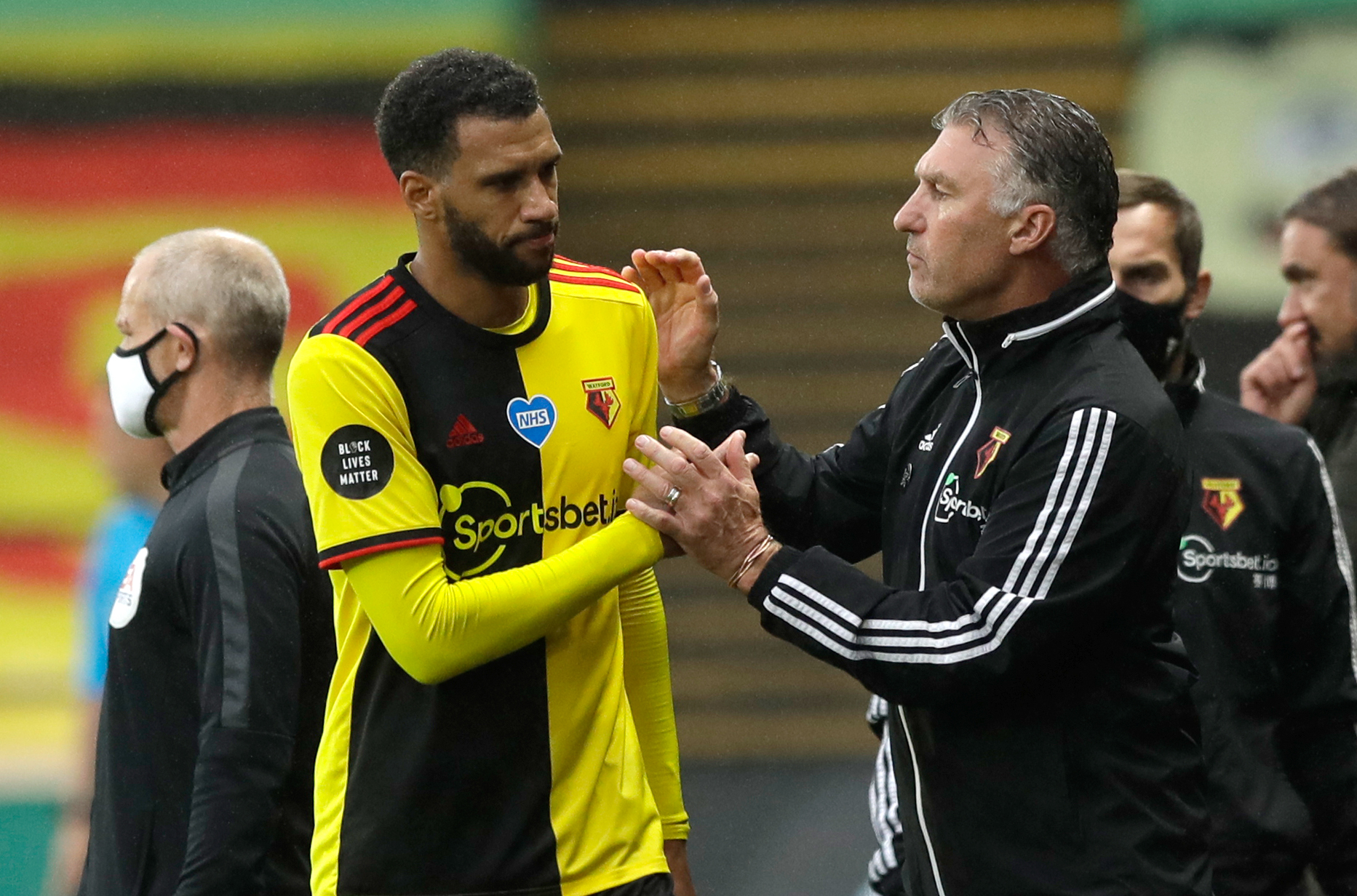 Watford manager Nigel Pearson greets Etienne Capoue (left) as he is substituted off the pitch during the Premier League match at Vicarage Road, Watford.