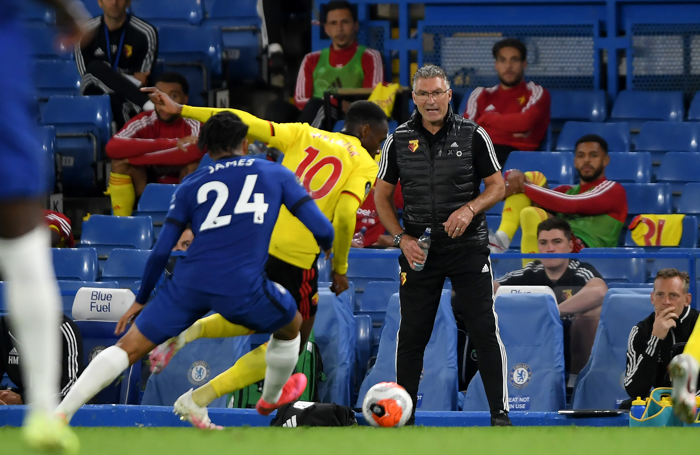 Watford manager Nigel Pearson watches from the touchline during the Premier League match at Stamford Bridge, London.