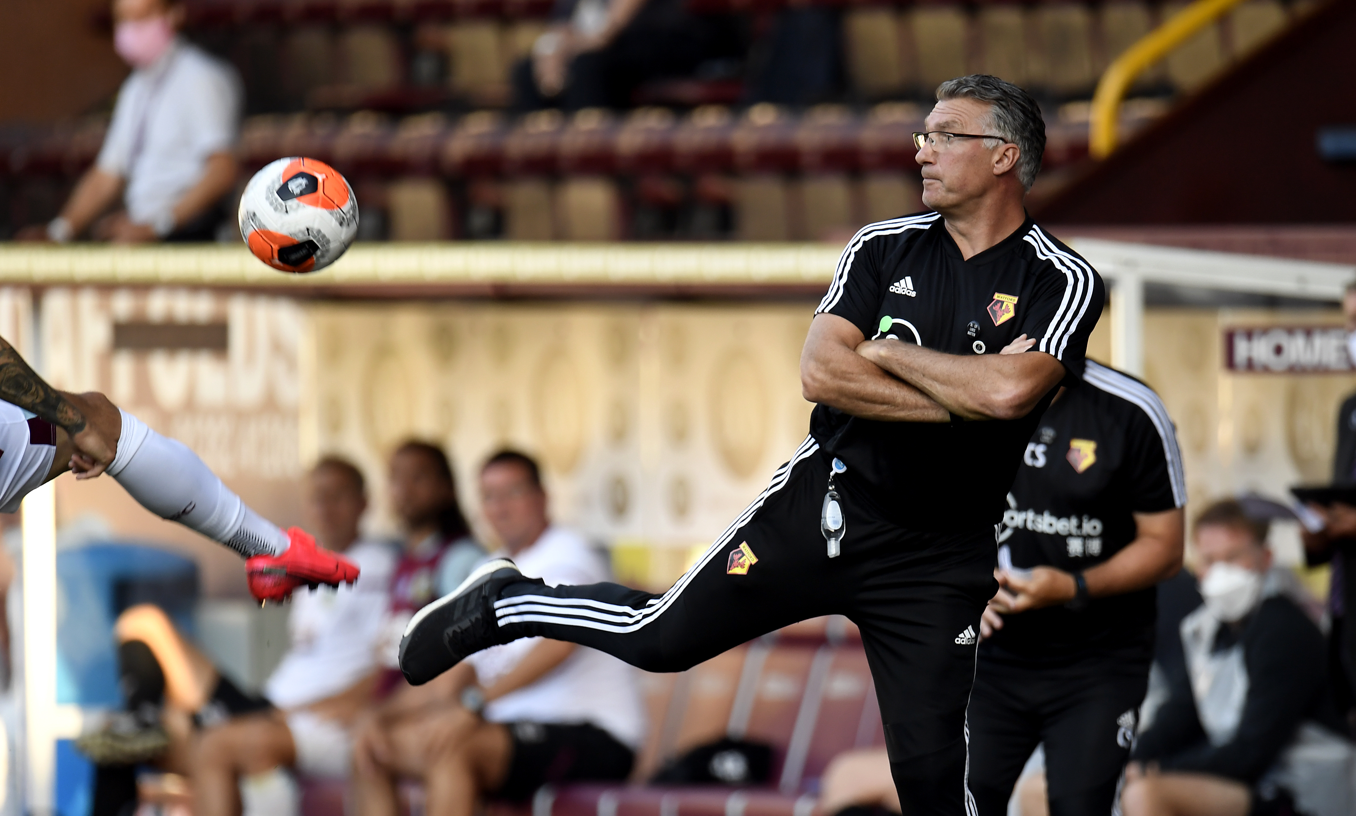 Watford manager Nigel Pearson controls the ball on the touchline during the Premier League match at Turf Moor, Burnley.