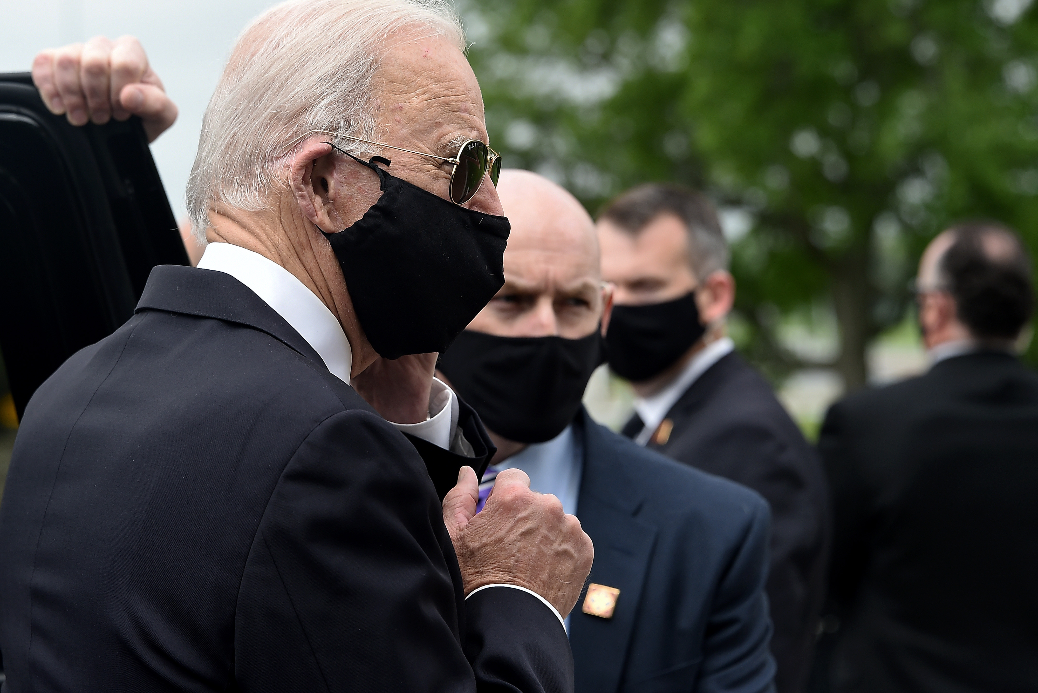 Democratic presidential candidate and former US Vice President Joe Biden (L) departs the Delaware Memorial Bridge Veteran's Memorial Park after paying respects to fallen service members in New Castle, Delaware, May 25, 2020. - Joe Biden, the presumptive Democratic presidential nominee, emerged from more than two months of seclusion on May 25, wearing a black face mask during a visit to lay a wreath on the day the United States honors its war dead. Biden's last public appearance was March 15 when he faced off against his former Democratic rival Bernie Sanders for a debate in a television studio held with no live audience. (Photo by Olivier DOULIERY / AFP) (Photo by OLIVIER DOULIERY/AFP via Getty Images)