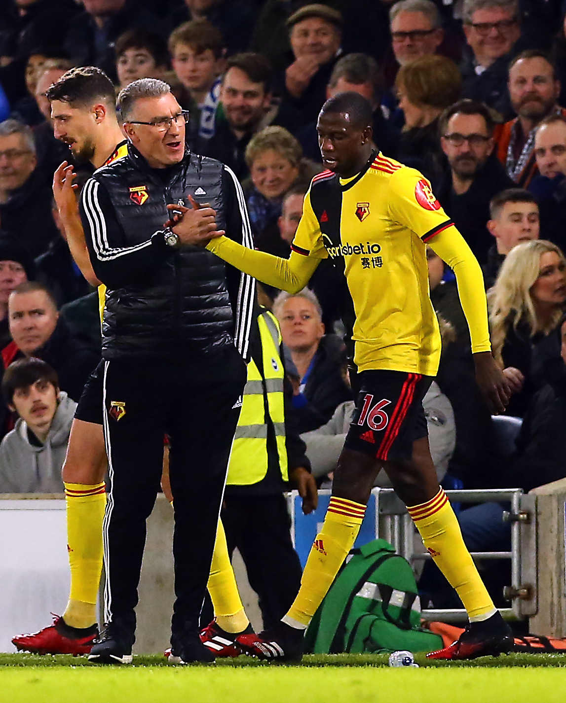 Watford's Abdoulaye Doucoure celebrates scoring his side's first goal of the game with manager Nigel Pearson