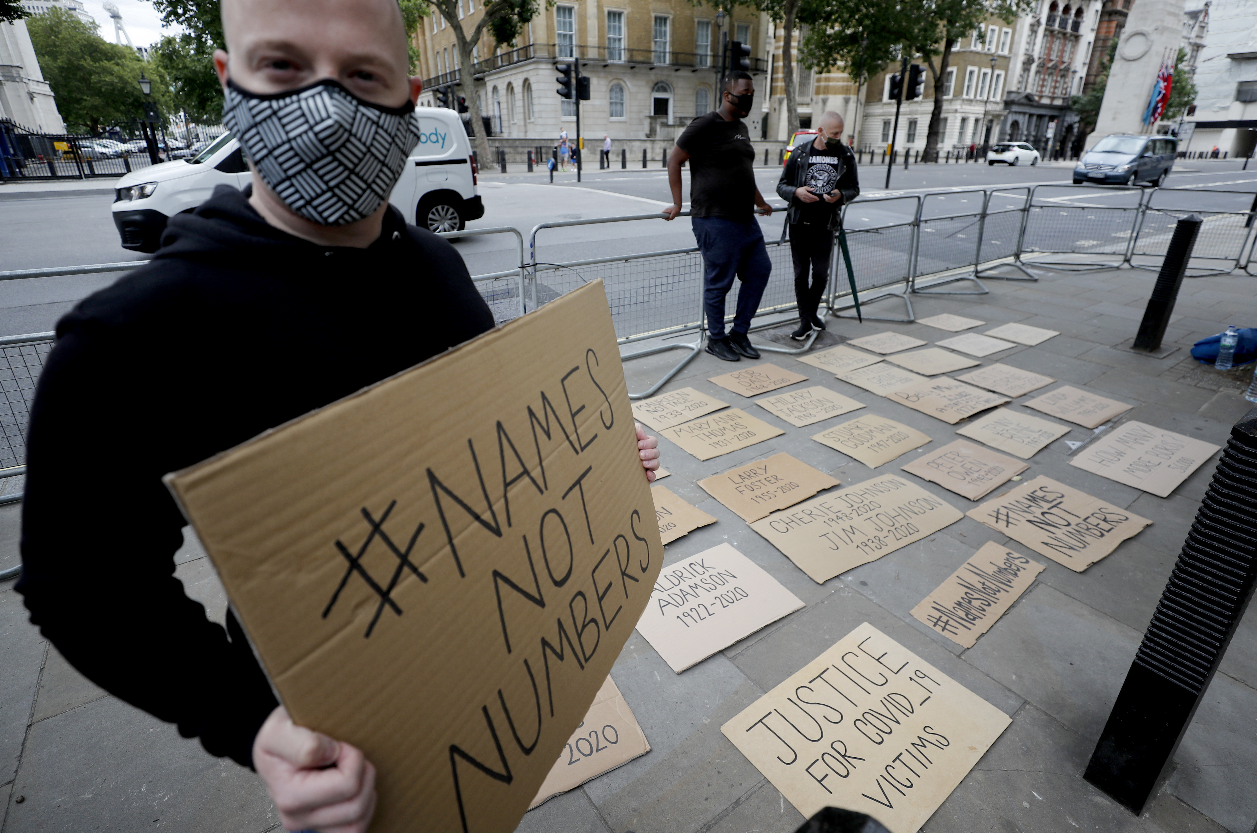 Posters with names of people that died during the COVID-19 pandemic are placed in front of the entrance to Downing Street in London, Wednesday, July 15, 2020. (AP Photo/Frank Augstein)