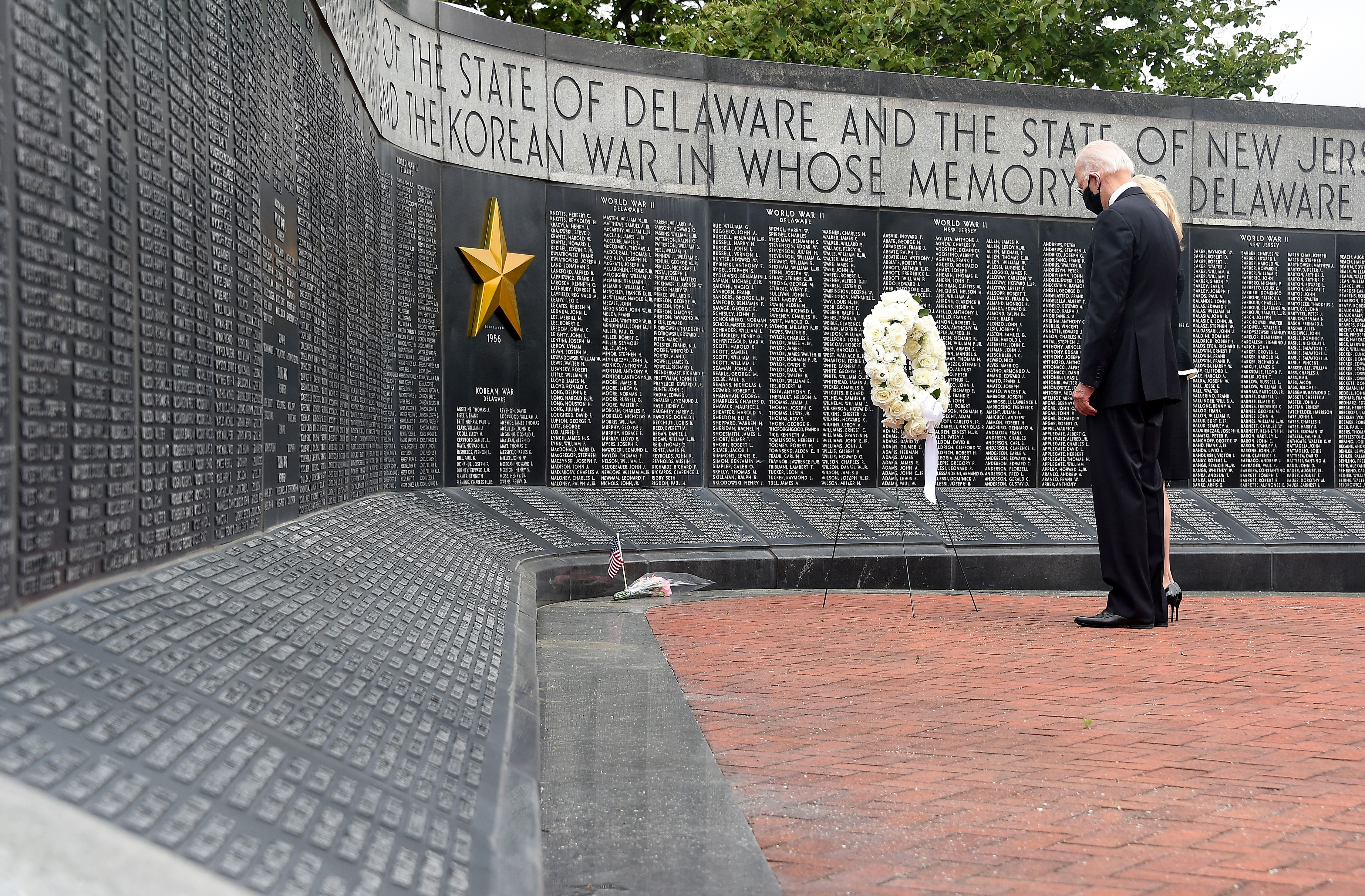 Democratic presidential candidate and former US Vice President Joe Biden and his wife Jill Biden, pay their respects to fallen service members on Memorial Day at Delaware Memorial Bridge Veteran's Memorial Park in Newcastle, Delaware, May 25, 2020. (Photo by Olivier DOULIERY / AFP) (Photo by OLIVIER DOULIERY/AFP via Getty Images)