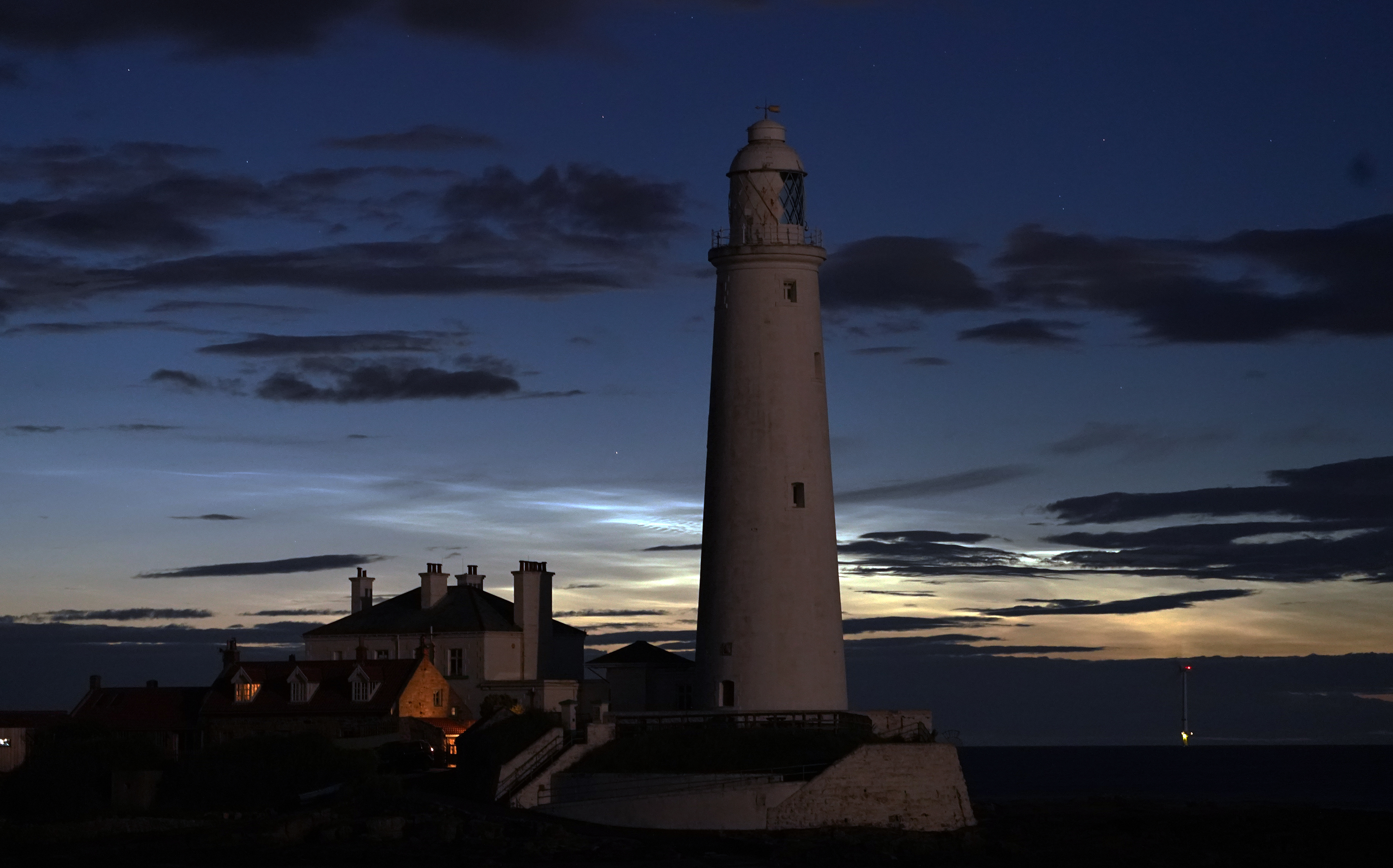 Noctilucent clouds or night clouds forming behind St Mary's Lighthouse in Whitley Bay. The clouds appear when the sun is 6-16 degrees below the Horizon. (Photo by Owen Humphreys/PA Images via Getty Images)