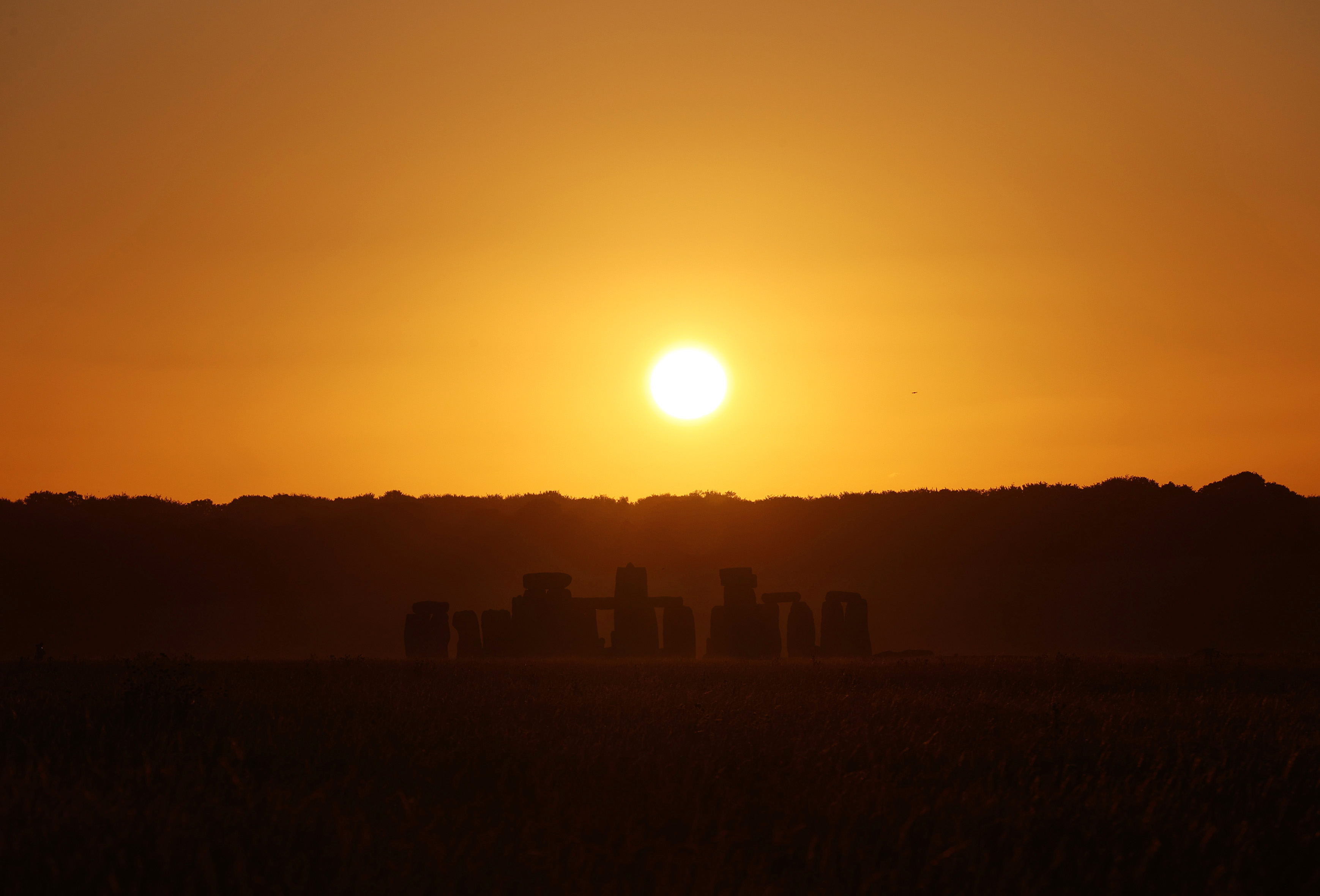 The sun rises above Stonehenge in Wiltshire. (Photo by Yui Mok/PA Images via Getty Images)