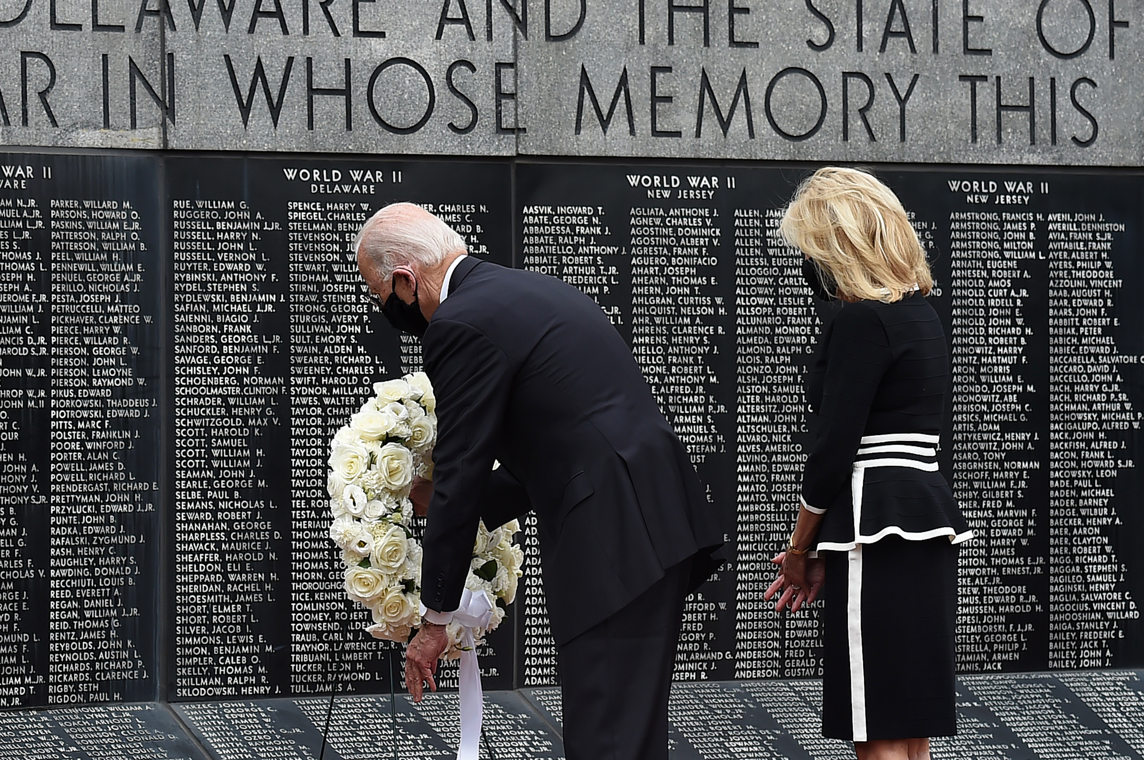Democratic presidential candidate and former US Vice President Joe Biden with his wife Jill Biden, pay their respects to fallen service members on Memorial Day at Delaware Memorial Bridge Veteran's Memorial Park in Newcastle, Delaware, May 25, 2020. (Photo by Olivier DOULIERY / AFP) (Photo by OLIVIER DOULIERY/AFP via Getty Images)
