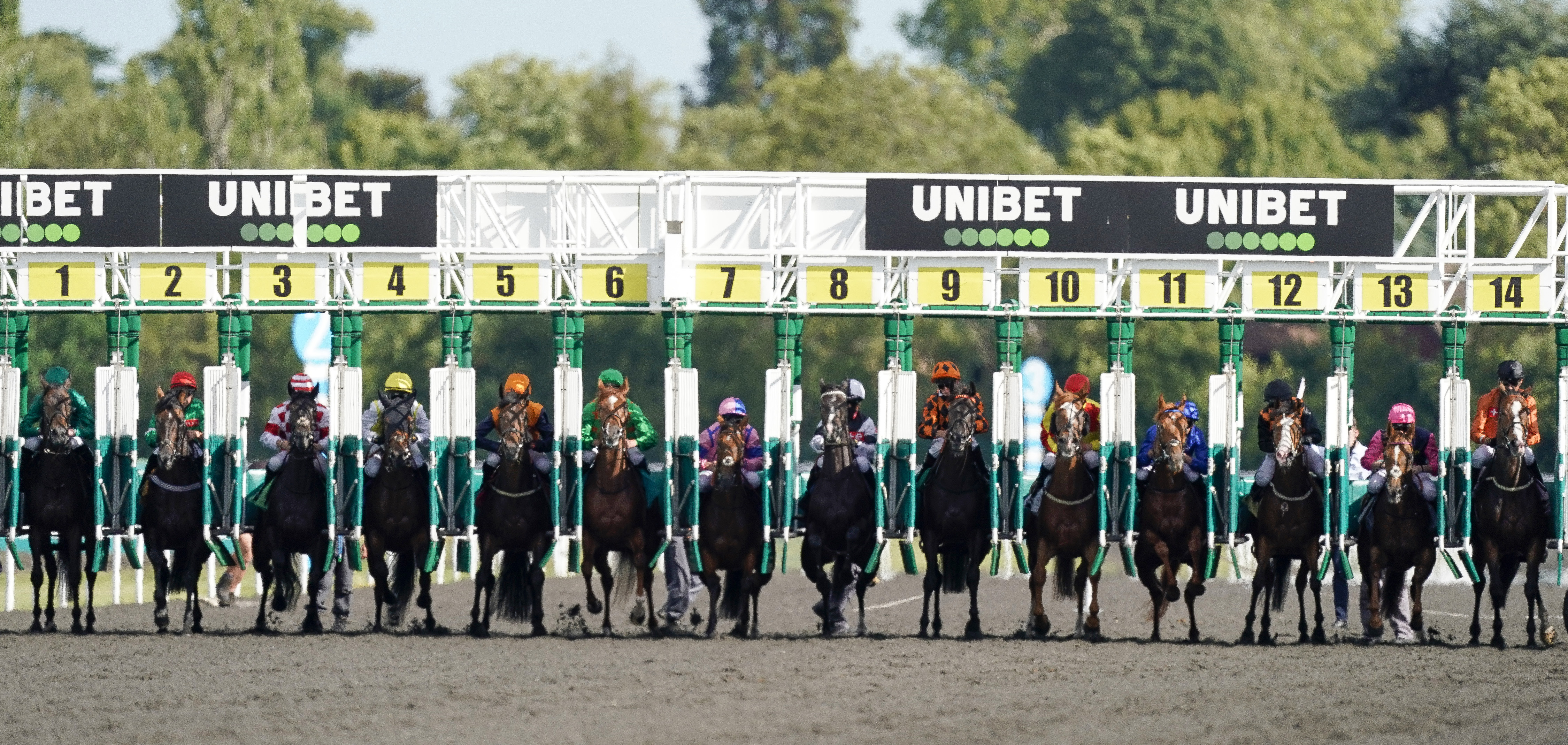 SUNBURY, ENGLAND - JULY 13: Runners in The Unibet Thanks The Frontline Workers Handicapn exit the starting stalls at Kempton Park on July 13, 2020 in Sunbury, England. Owners are allowed to attend if they have a runner at the meeting otherwise racing remains behind closed doors to the public due to the Coronavirus pandemic. (Photo by Alan Crowhurst/Getty Images)